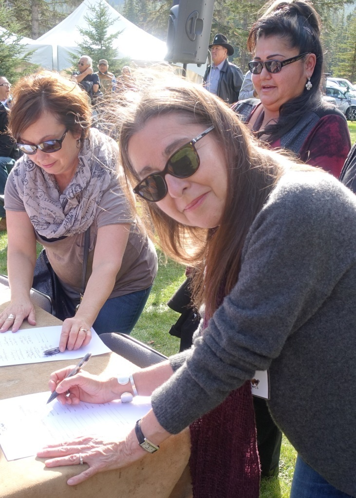 Photo by Rebecca Garvoille The Author Signing in Support of the Buffalo Treaty and Resolutions