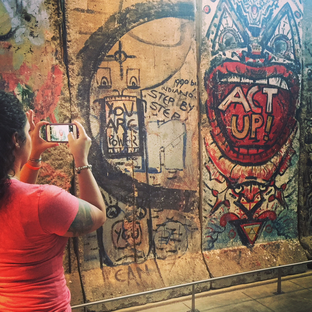 Me taking a photo of remnants of the Berlin Wall at the Newseum in Washington D.C.  Photo credit: Megan Slaughter