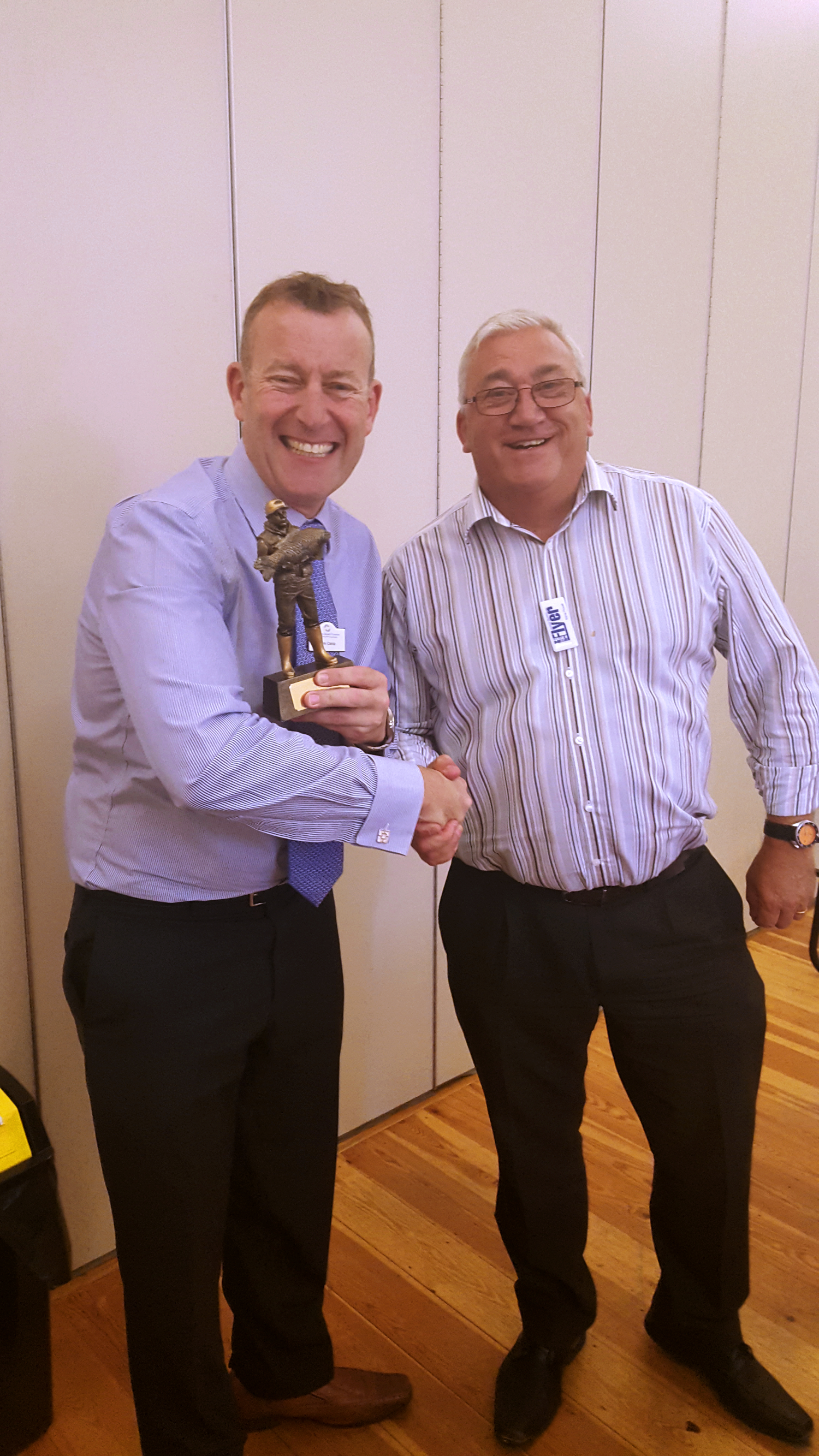 Mark Camp receiving the trophy from Steve Powell last weeks winner from the Bury Flyer.