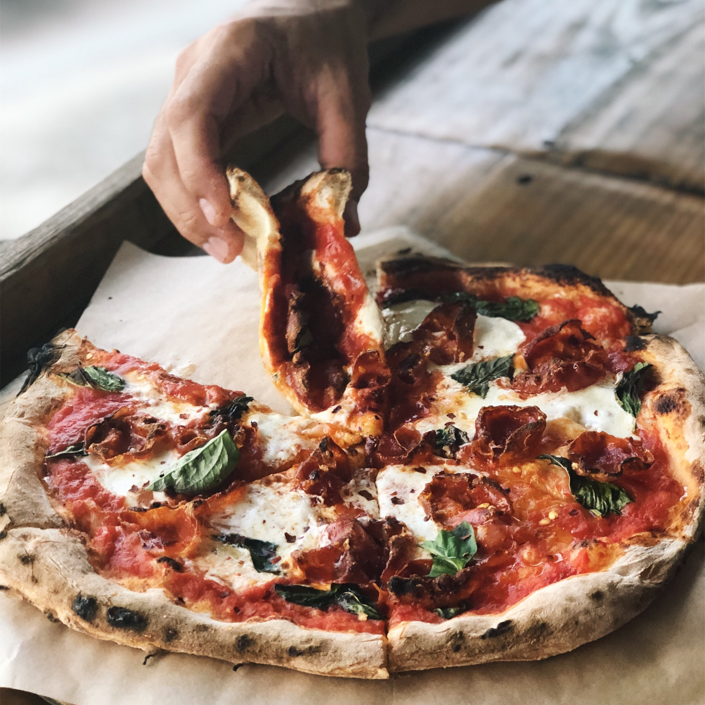 PiZZA PARADISE - Wood-fired savory pizza perfection.