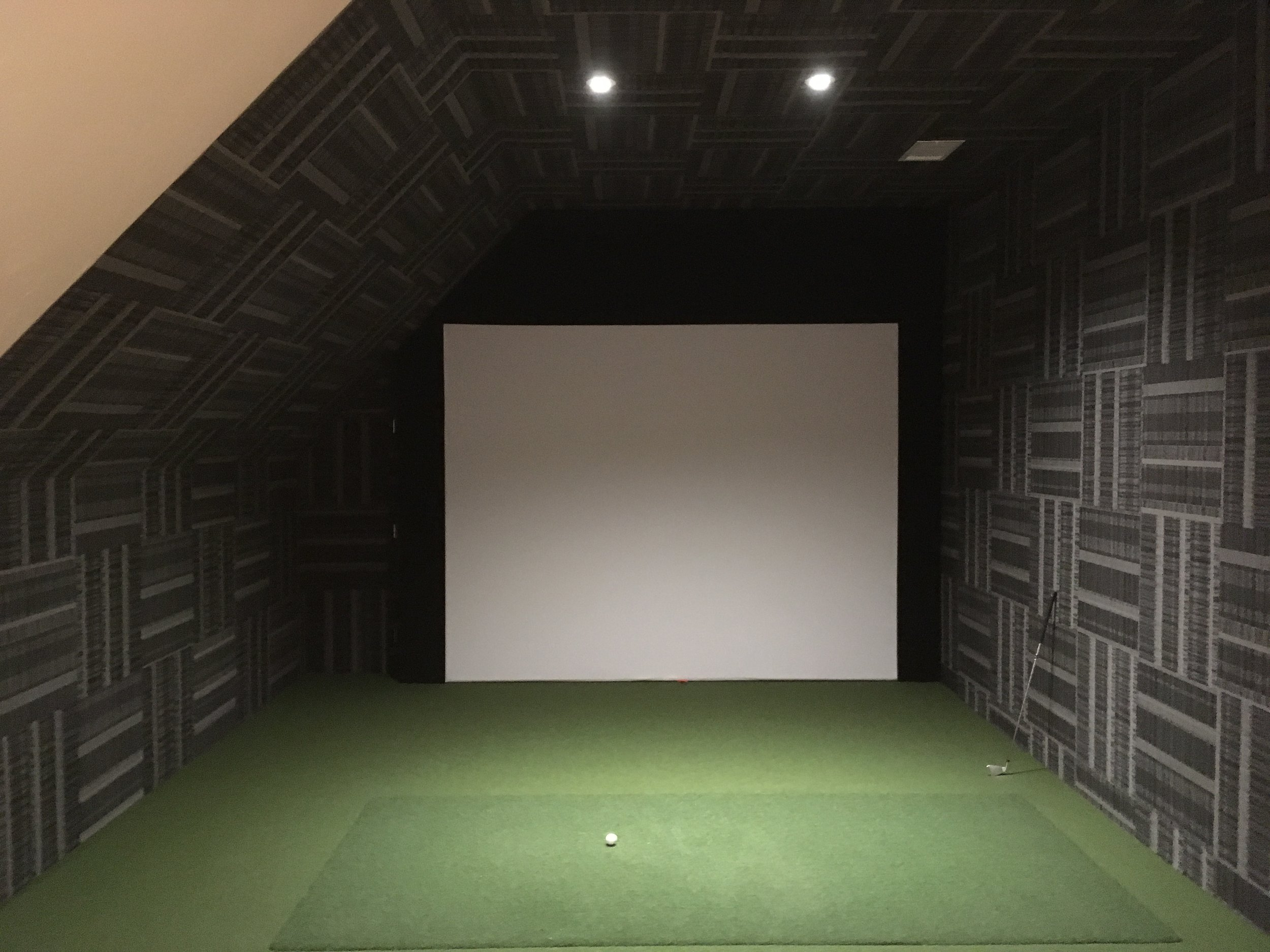 Attic space transformed into a personal golf simulator