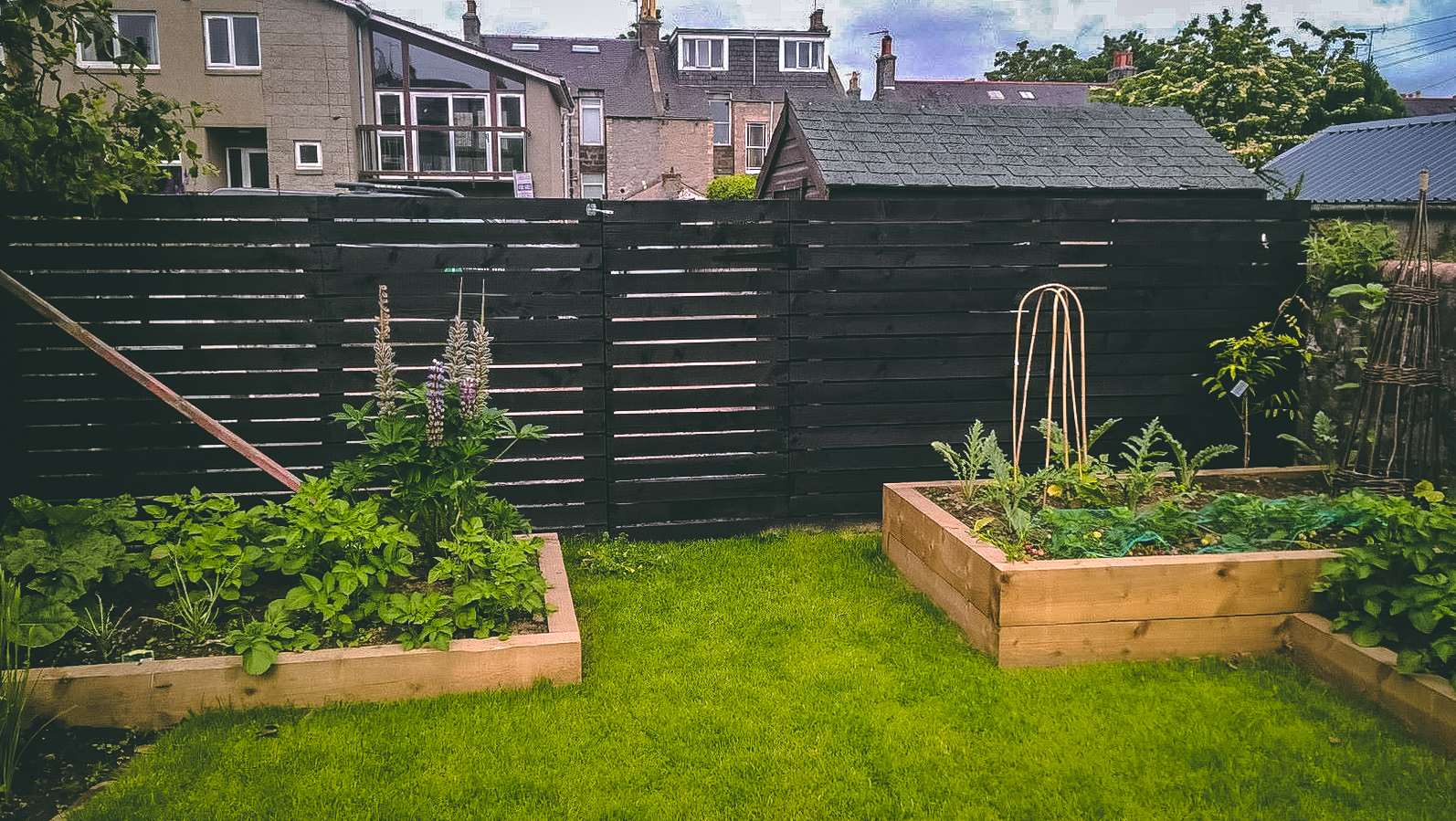Fencing and sleepers raised borders