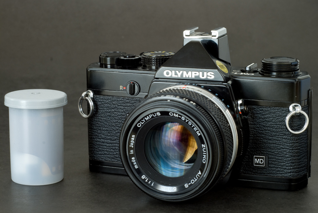 Nice size comparison for the Olympus OM-1 from  https://cameragx.com/2010/06/23/an-olympus-om-camera-to-rediscover-the-om-2s/