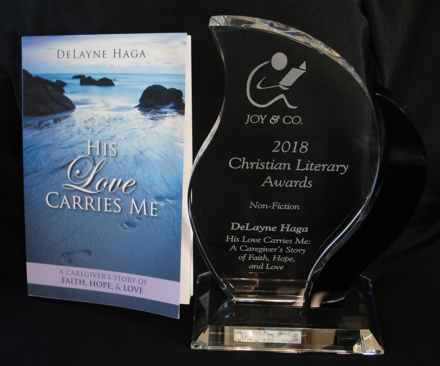 """His Love Carries Me  by DeLayne Haga - recipient of 2018 Christian Literary Award in Non-Fiction. The """"Henri Award"""" is the most prestigious award presented by Joy & Company."""