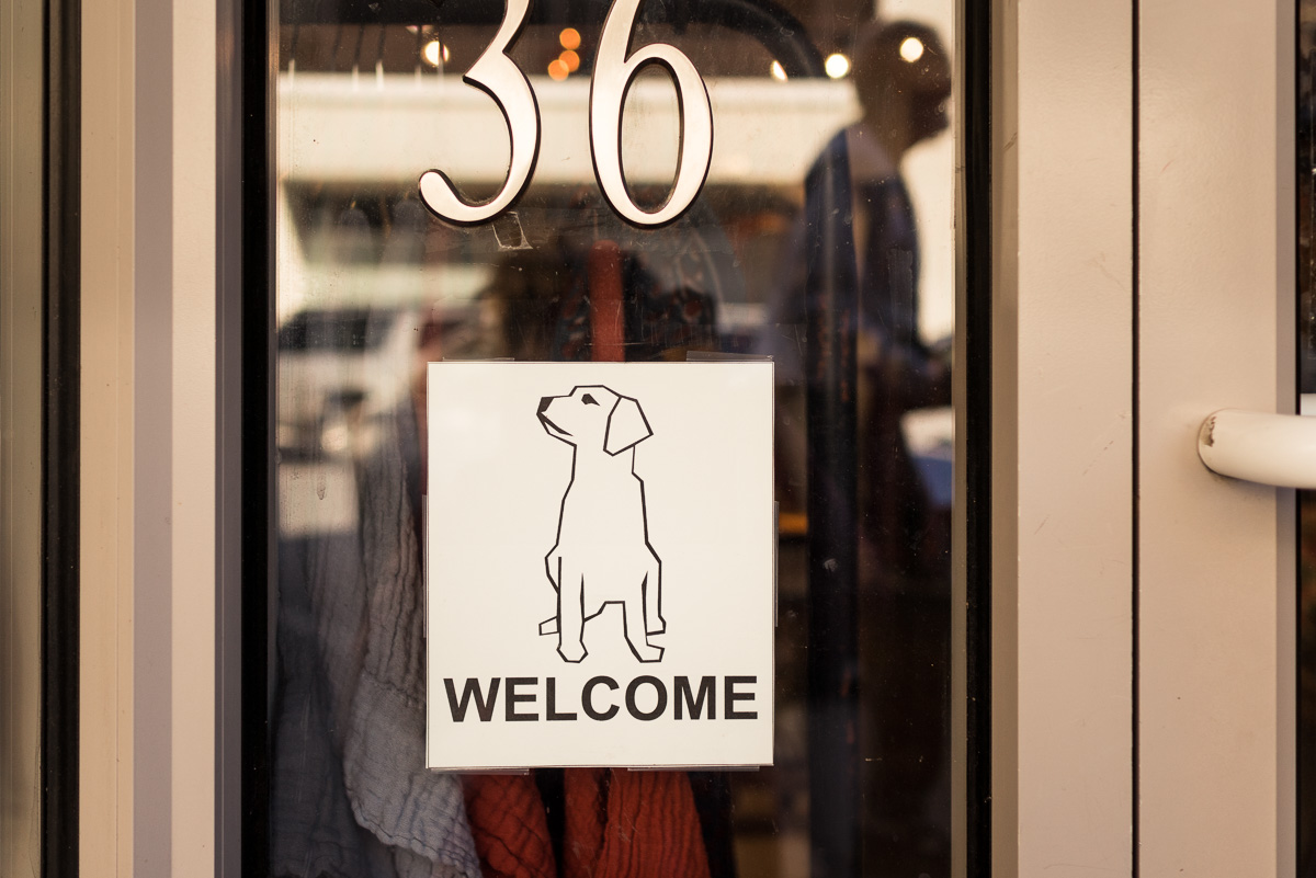 """A """"dogs welcome"""" sign on a downtown business offers proof of how dog-friendly Missoula is."""