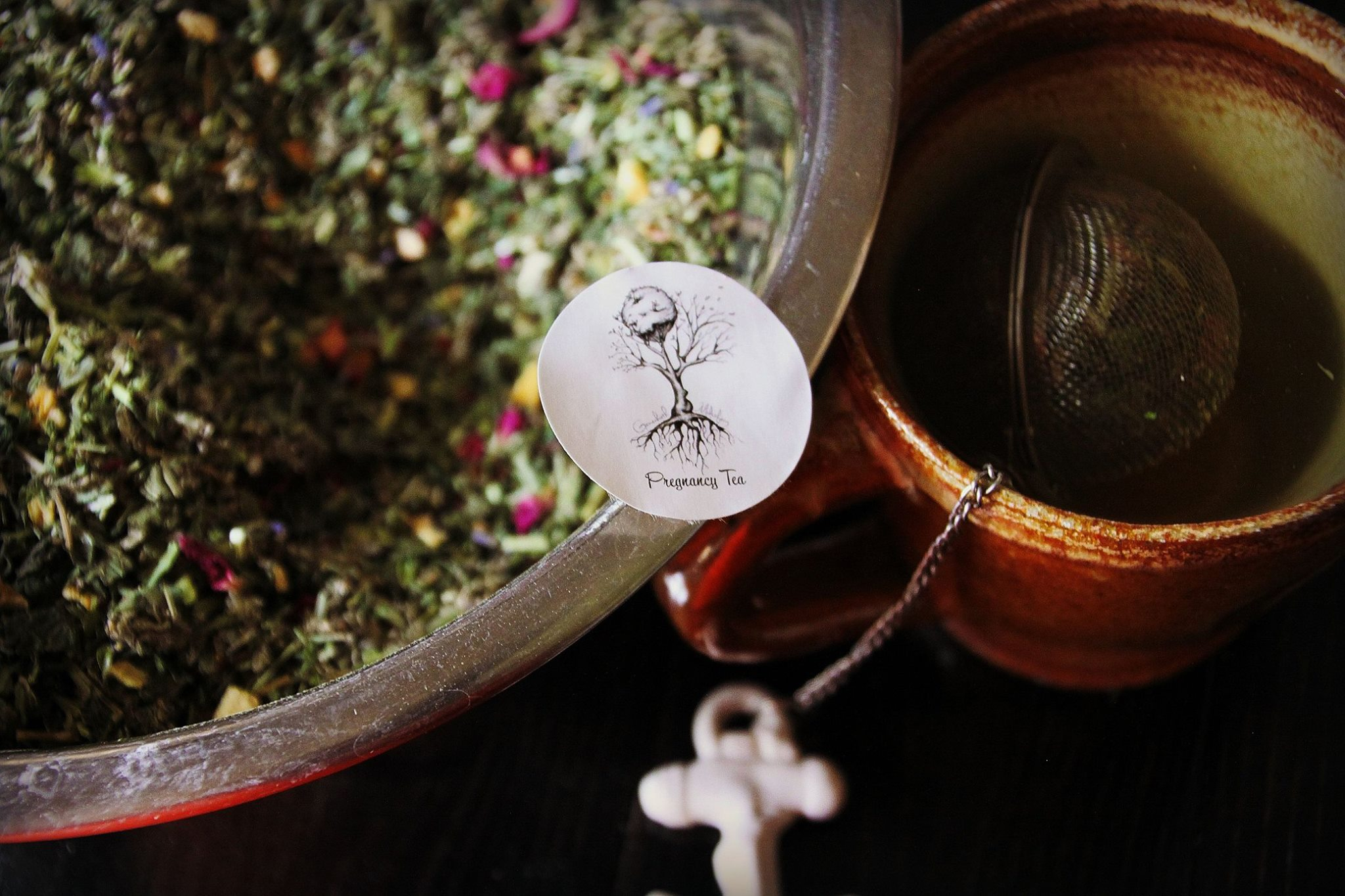 Bowl of dried herbs labelled pregnancy tea