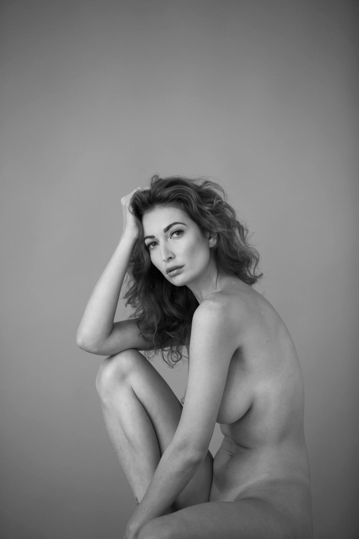 Nude female photographer