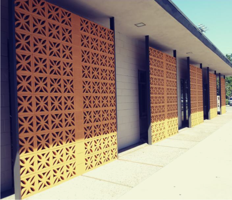The Germano Milono Building features iconic, decorative breeze bricks across its front and side. The front screen is made entirely of Maltese pattern blocks and the side screens are sunflower design.