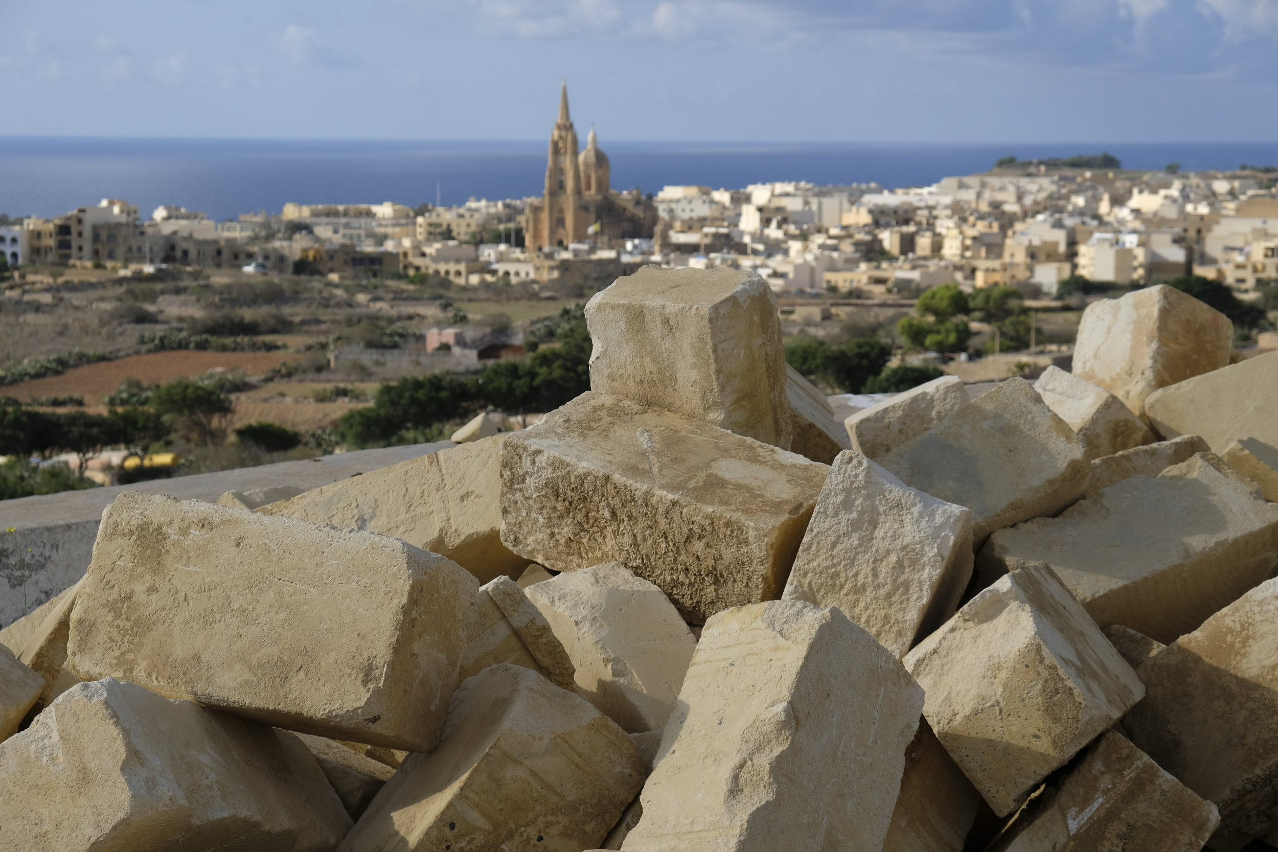 A view from the valley, with the sea to Malta in the background