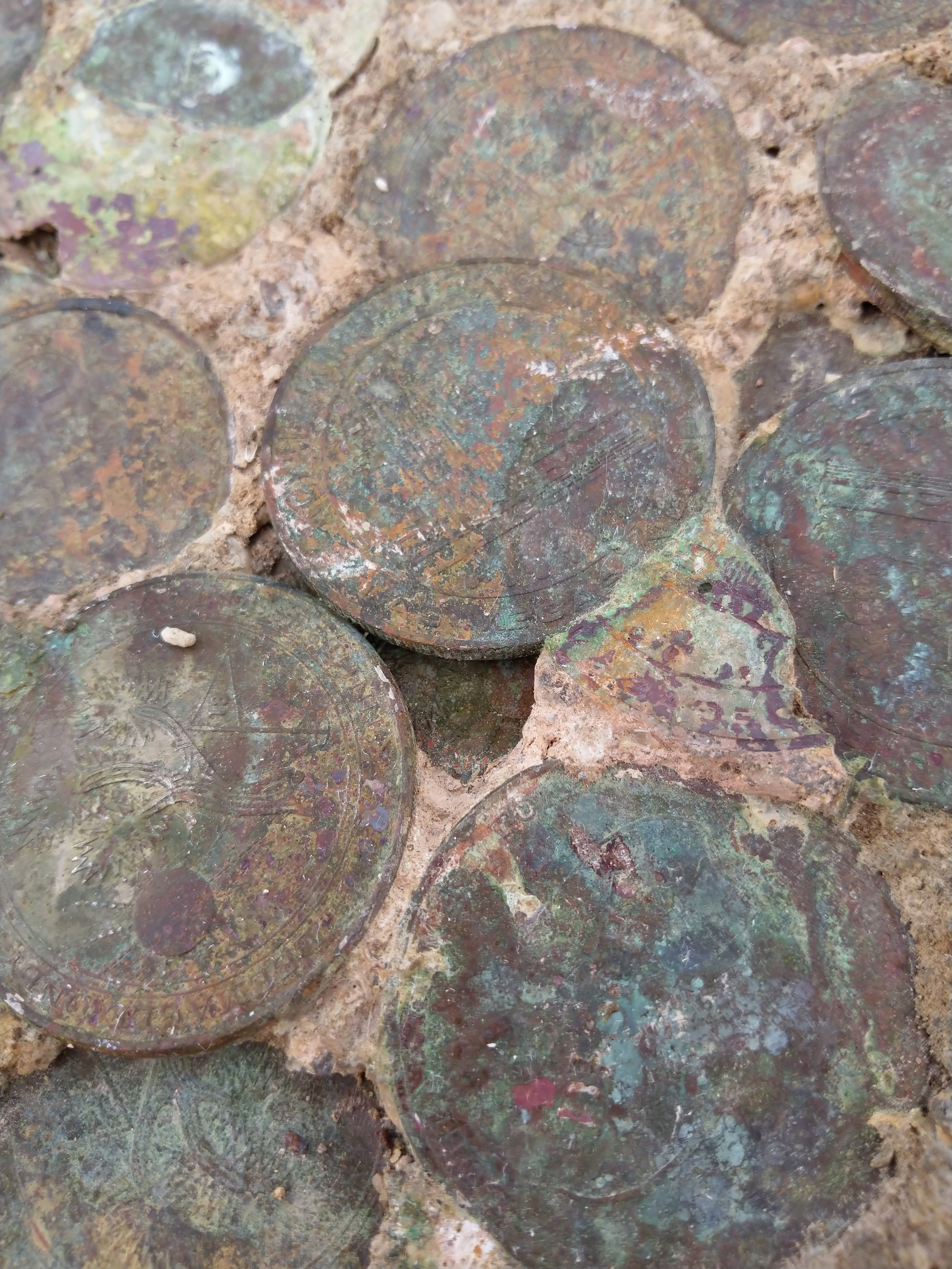 """This was being advertised as """"A fossil from Las Vegas, called 'Vegasite.'"""" If it's not immediately evident, this bit of strata and cement is populated by casino tokens in various states of decomposition and corrosion."""