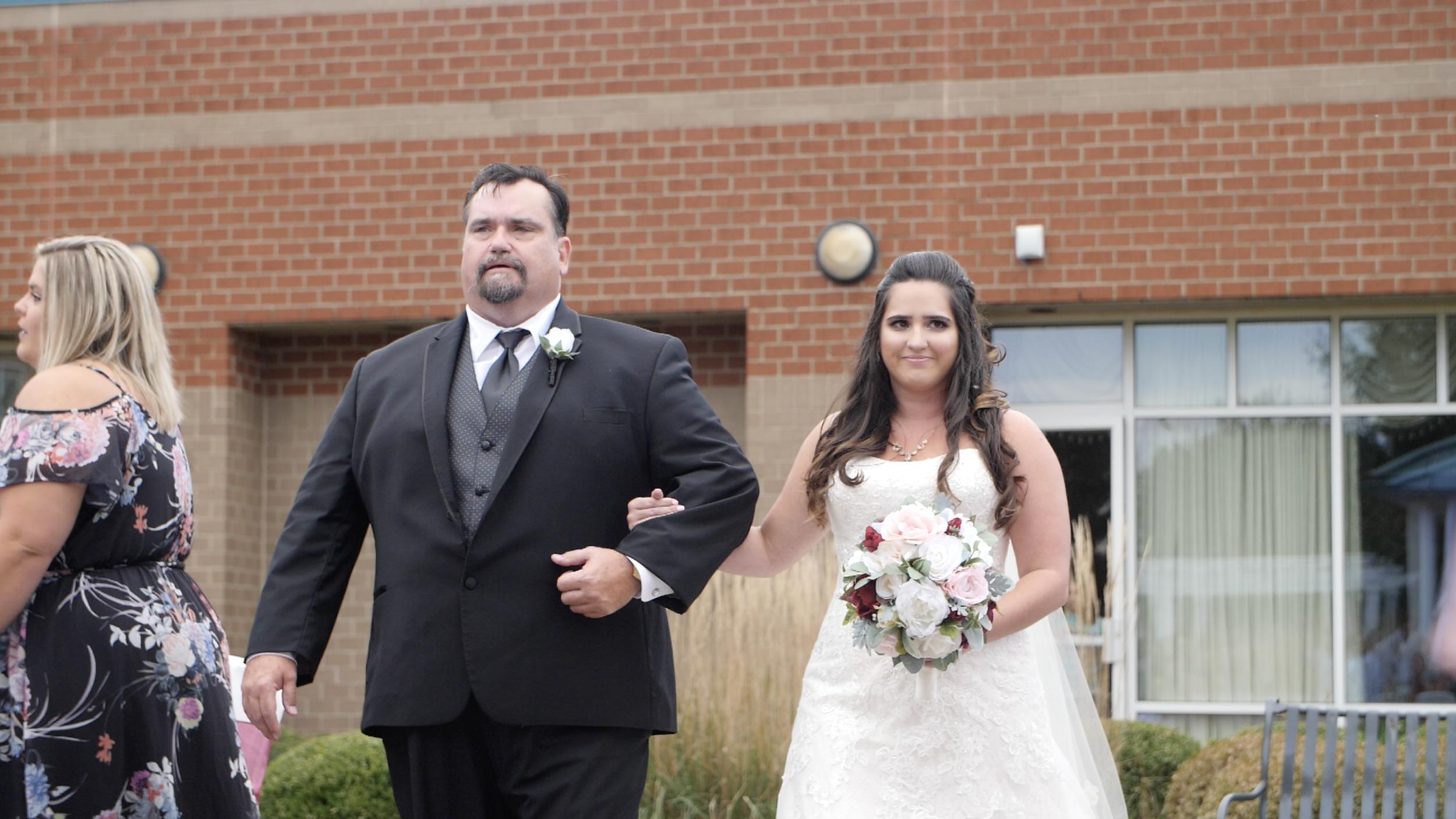 bride dad aisle wedding song outdoor videography