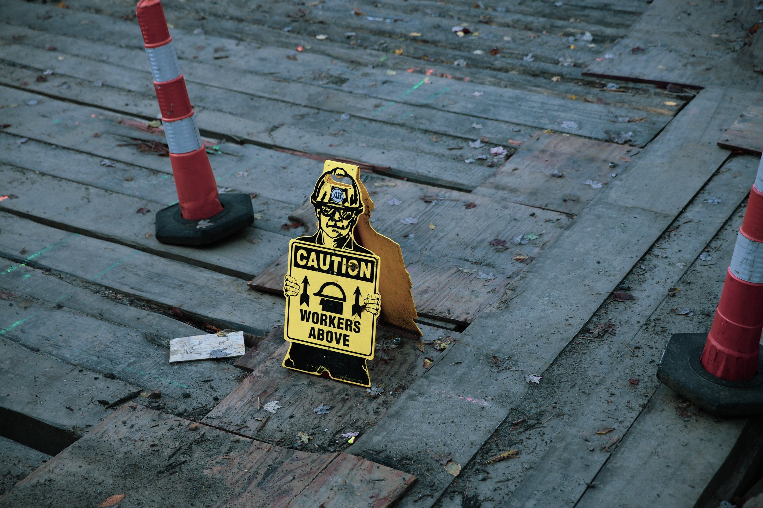 Caution sign construction workers