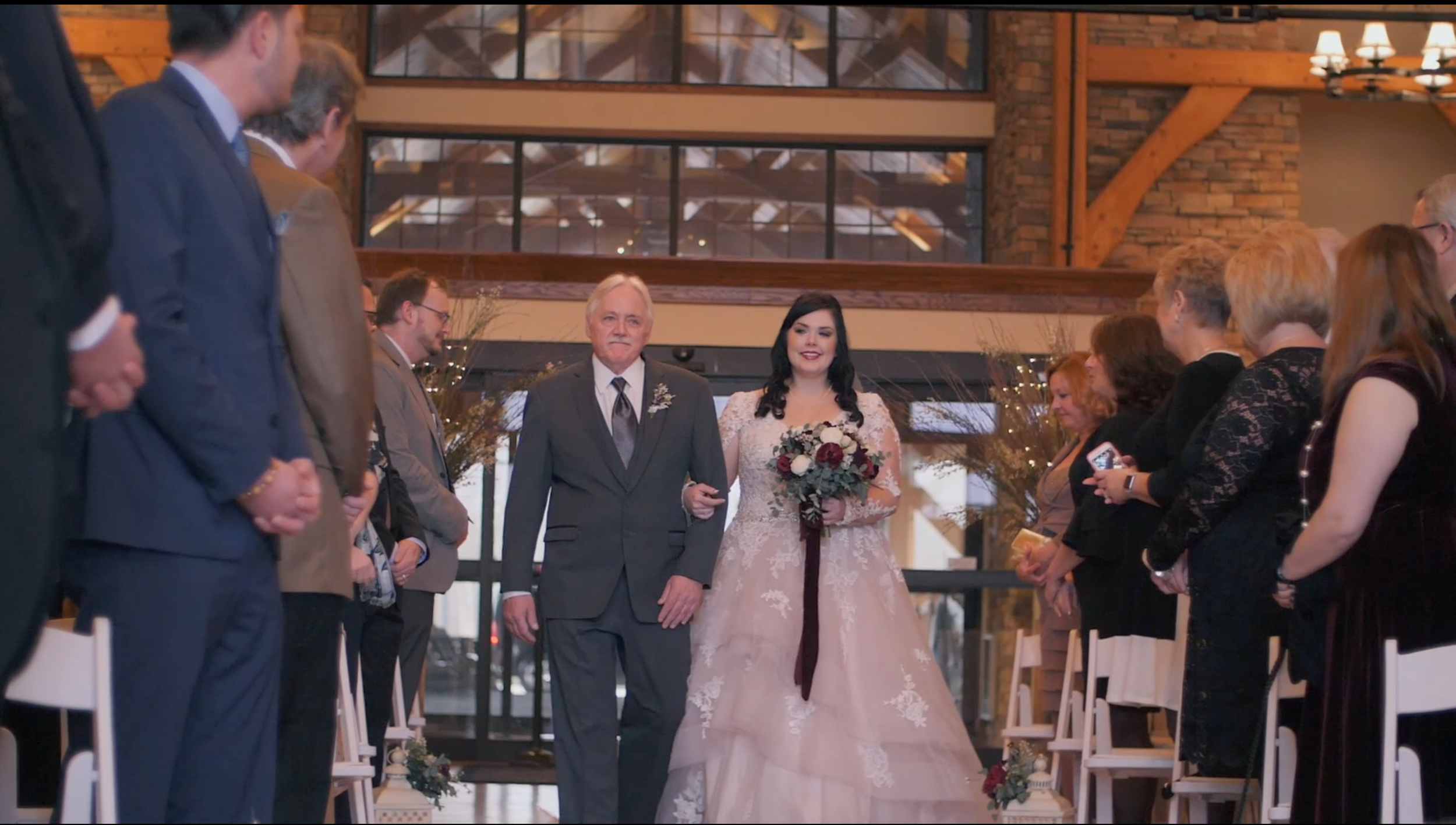 Bride aisle videography important moment winter stonewall indoor lobby