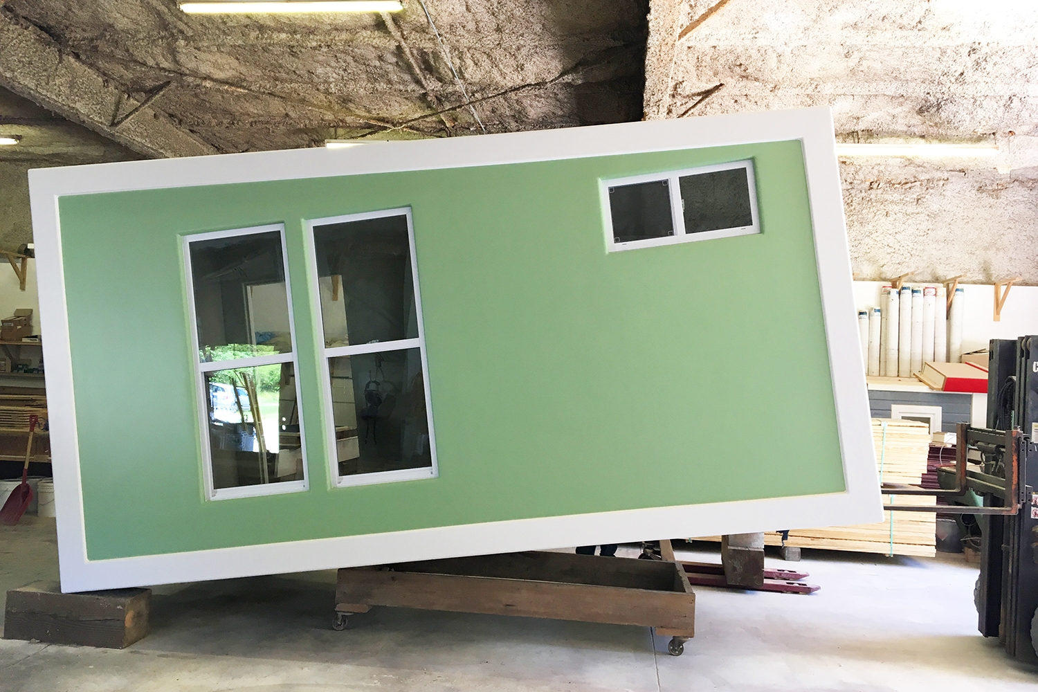 """The  sips walls of this """"the bayside rambler"""" tiny house are so stiff and lightweight, the entire house can be lifted with a forklift, hinging on one end."""
