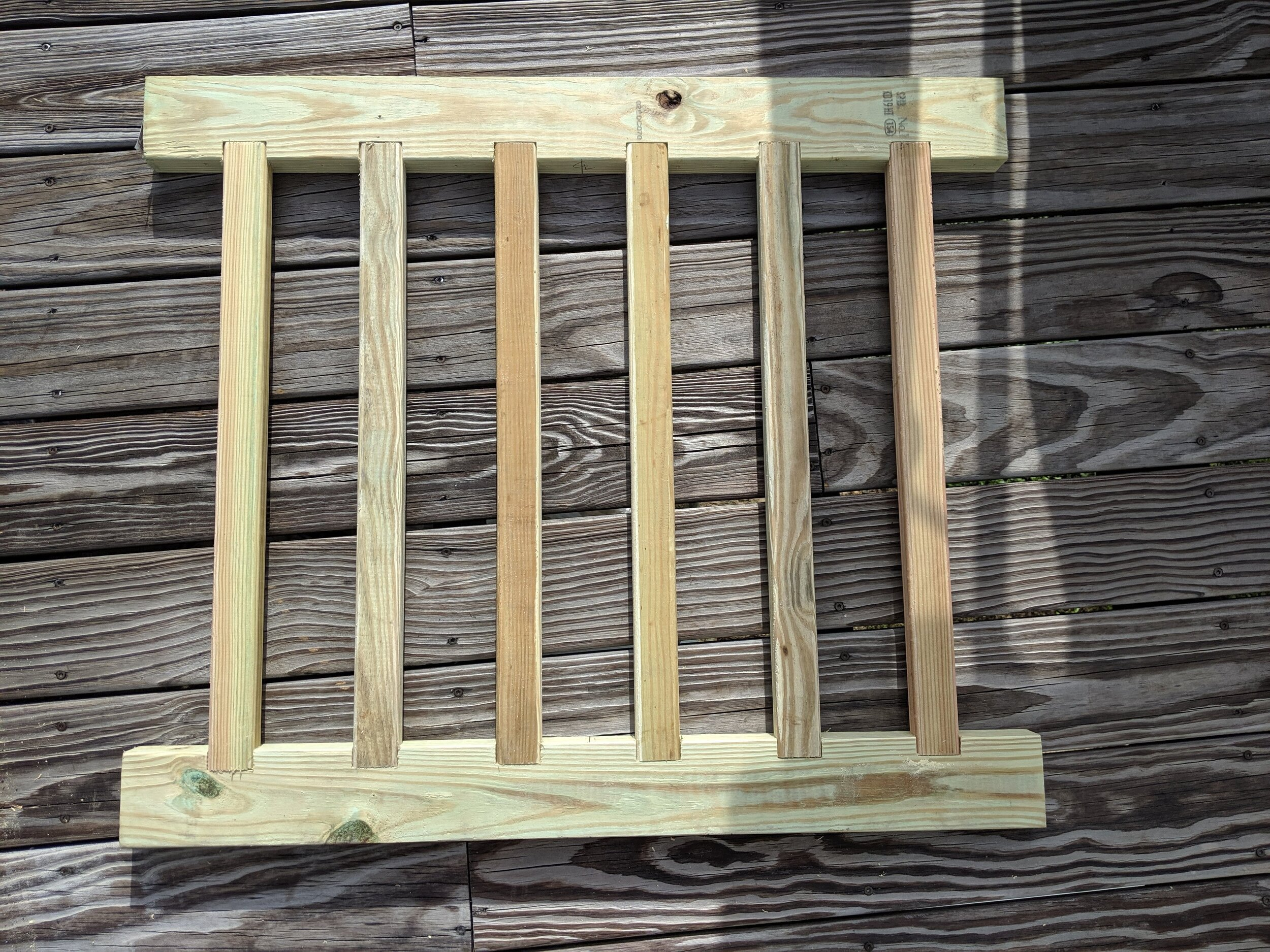 """a basic section of mortised pickets. these particular pickets mortise 1"""" into the top and bottom guard rails"""