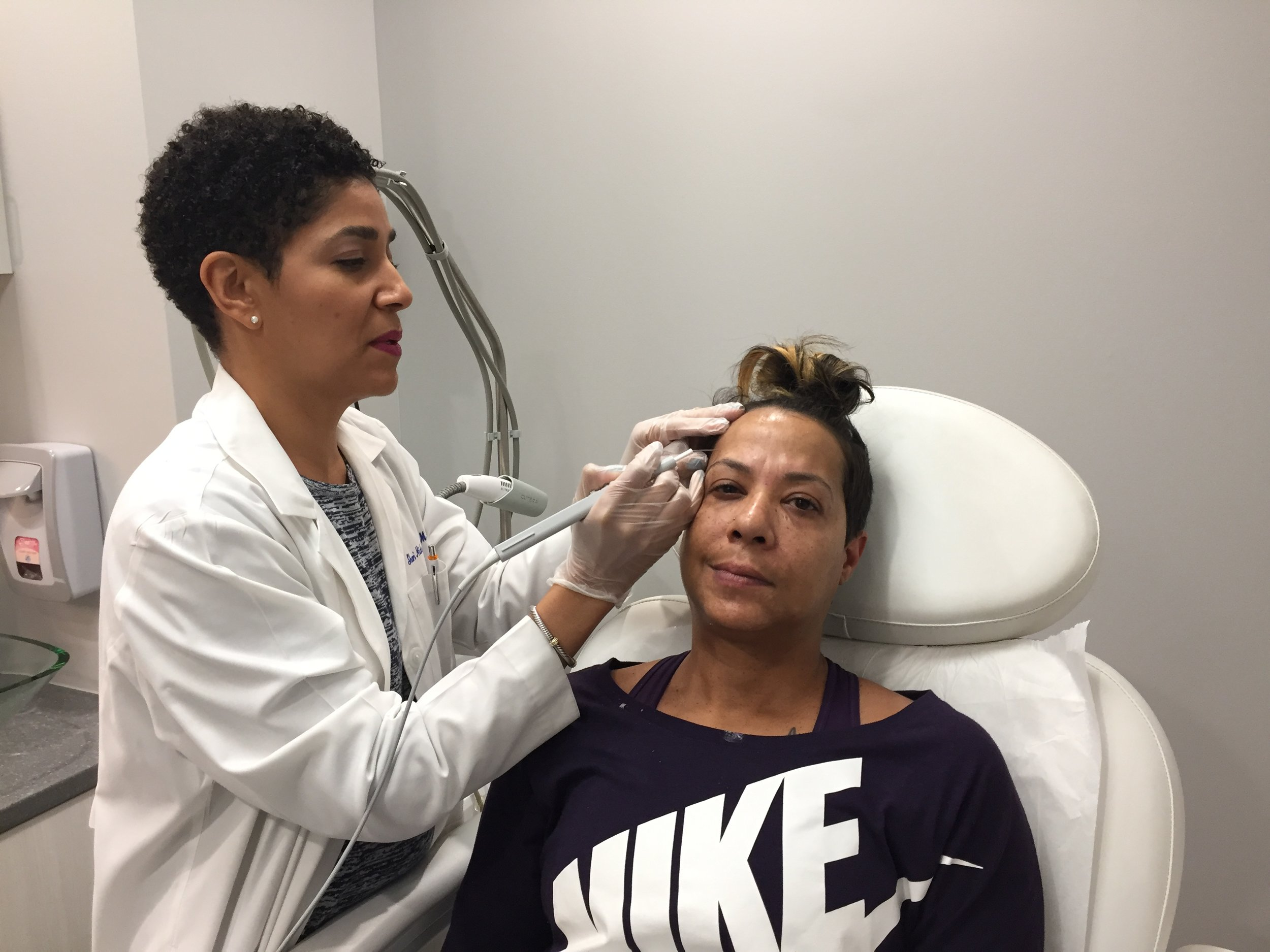 Image 1: The beginning of the process with the use of numbing cream BKA Lidocaine 2.5% she begin to remove the moles. Although any process is scary, Dr. Hicks-Graham made me feel very comfortable.