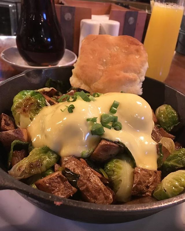 Bacon + brussel sprouts = a match made in skillet heaven! Add home fried potatoes, poached eggs and hollandaise, with choice of bread and #getscrambled!
