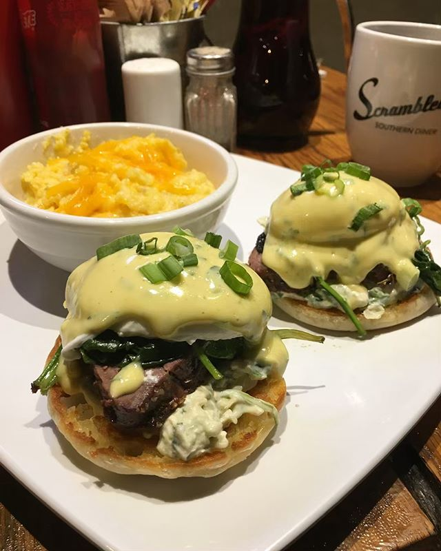 Our Benedict's Row just got a new addition! For a limited time try the Beef Tenderloin Benedict with spinach artichoke dip and steamed spinach topped with ramp hollandaise and scallions. #getscrambled 🍳