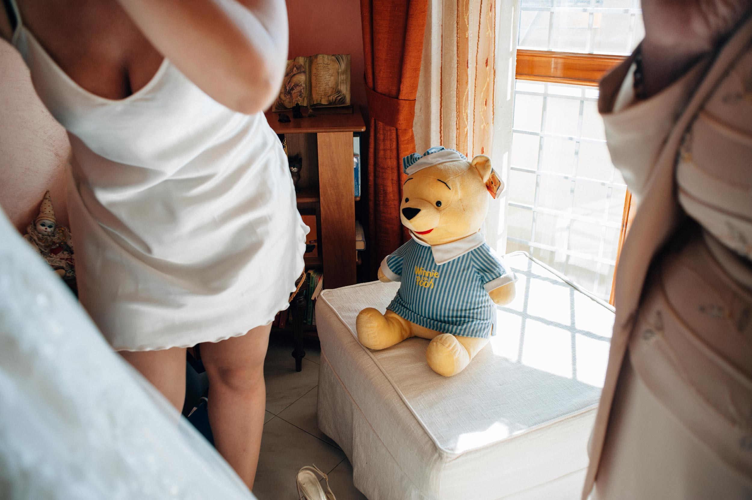 astonished-winnie-the-pooh-looks-at-the-bride-getting-ready-in-underwear.jpg
