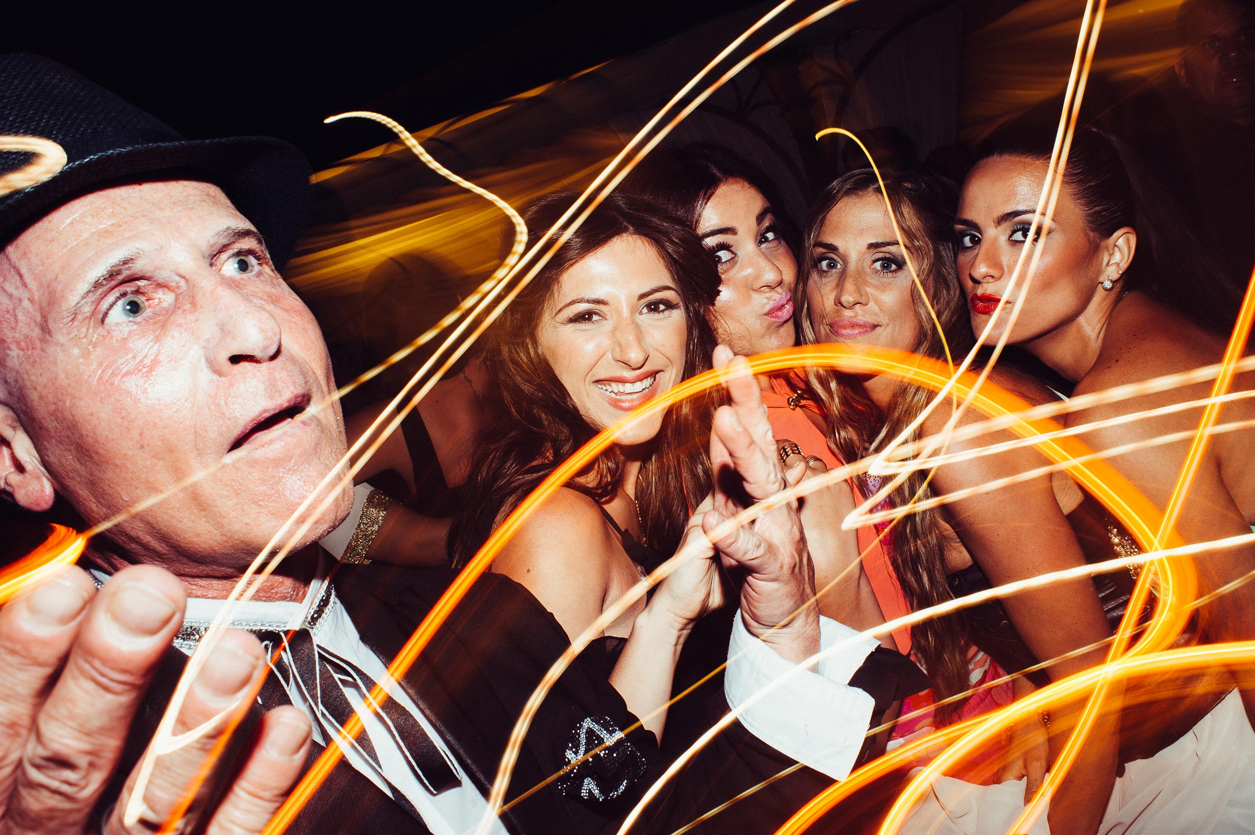beautiful-girls-and-astonished-eccentric-man-reception-party-wedding-in-naples.jpg