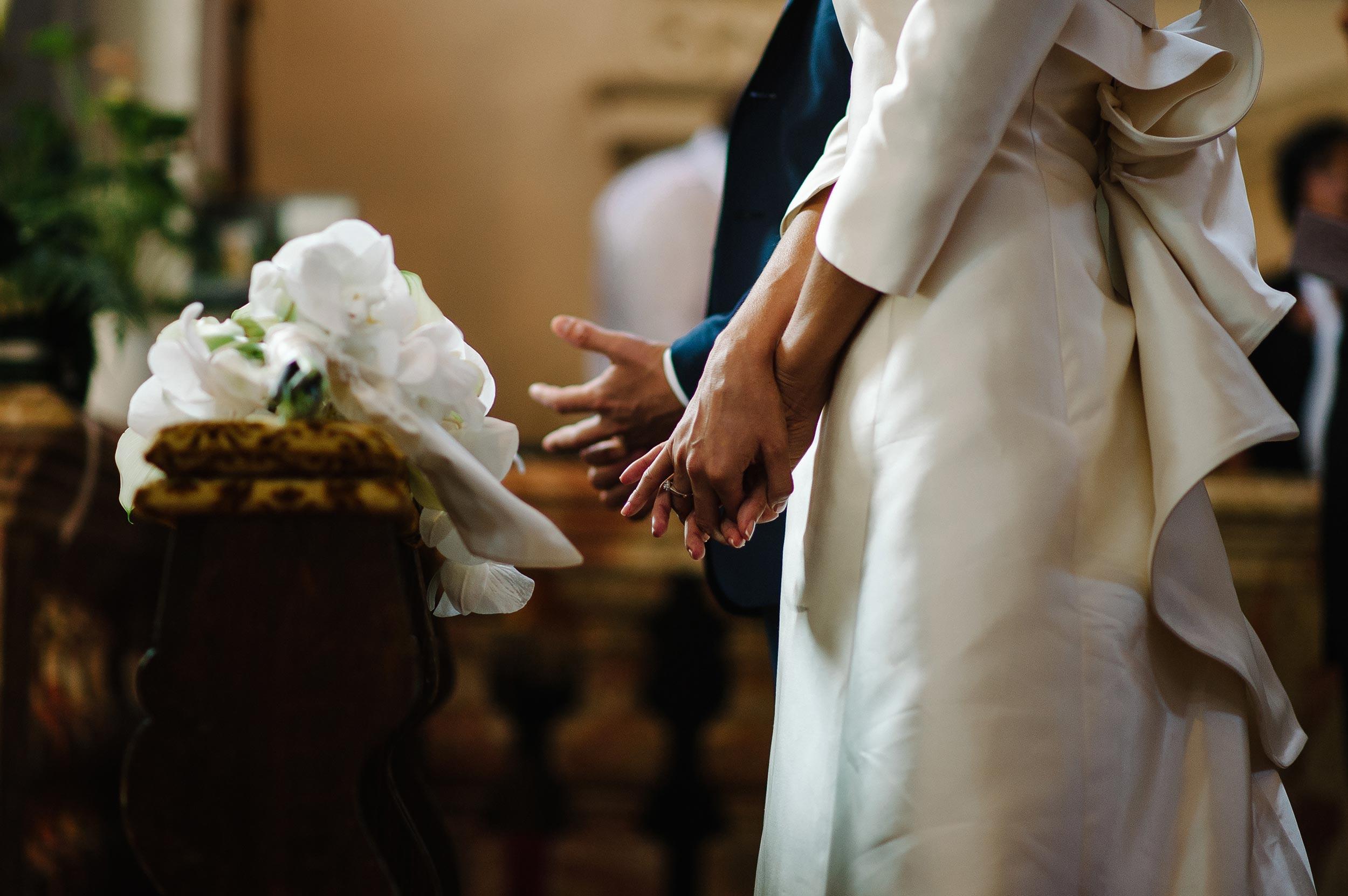 bride-and-groom-hands-touching-their-rings-after-rings-exchange-lugano-switzerlang.jpg