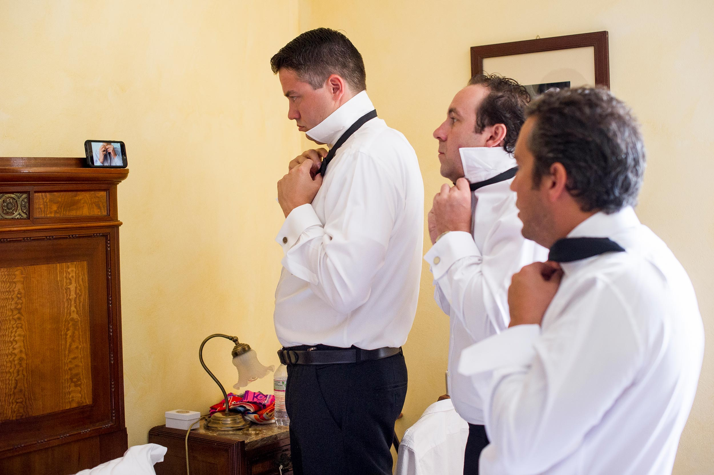 groomsmen-trying-to-learn-from-youtube-how-to-make-the-bow-tie.jpg