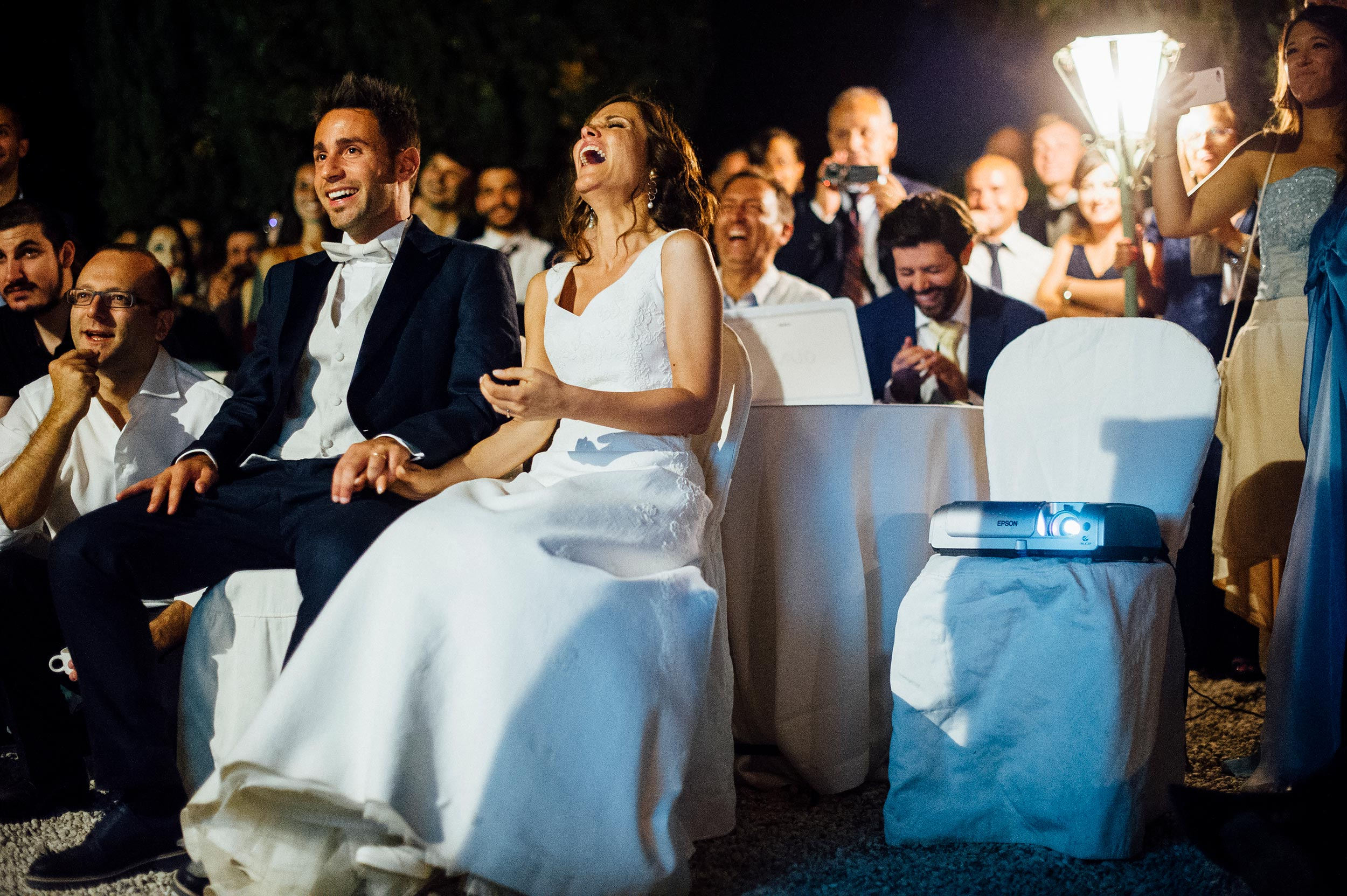 the-bride-and-groom-laughing-at-their-surprise-video.jpg
