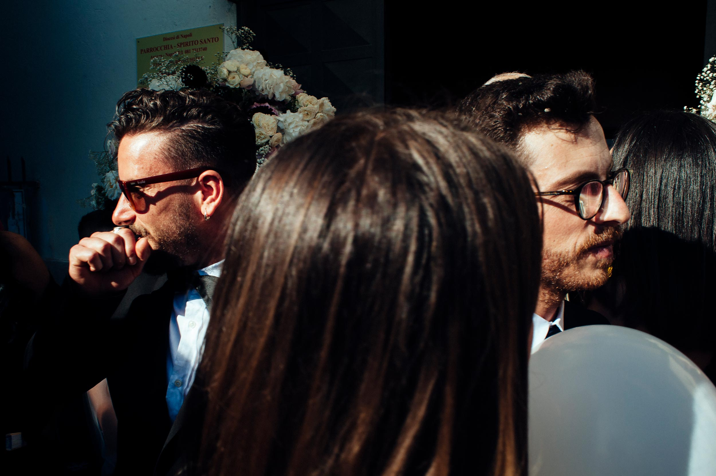 the-groom-and-his-brother-outside-the-church-street-photography-wedding-italy.jpg