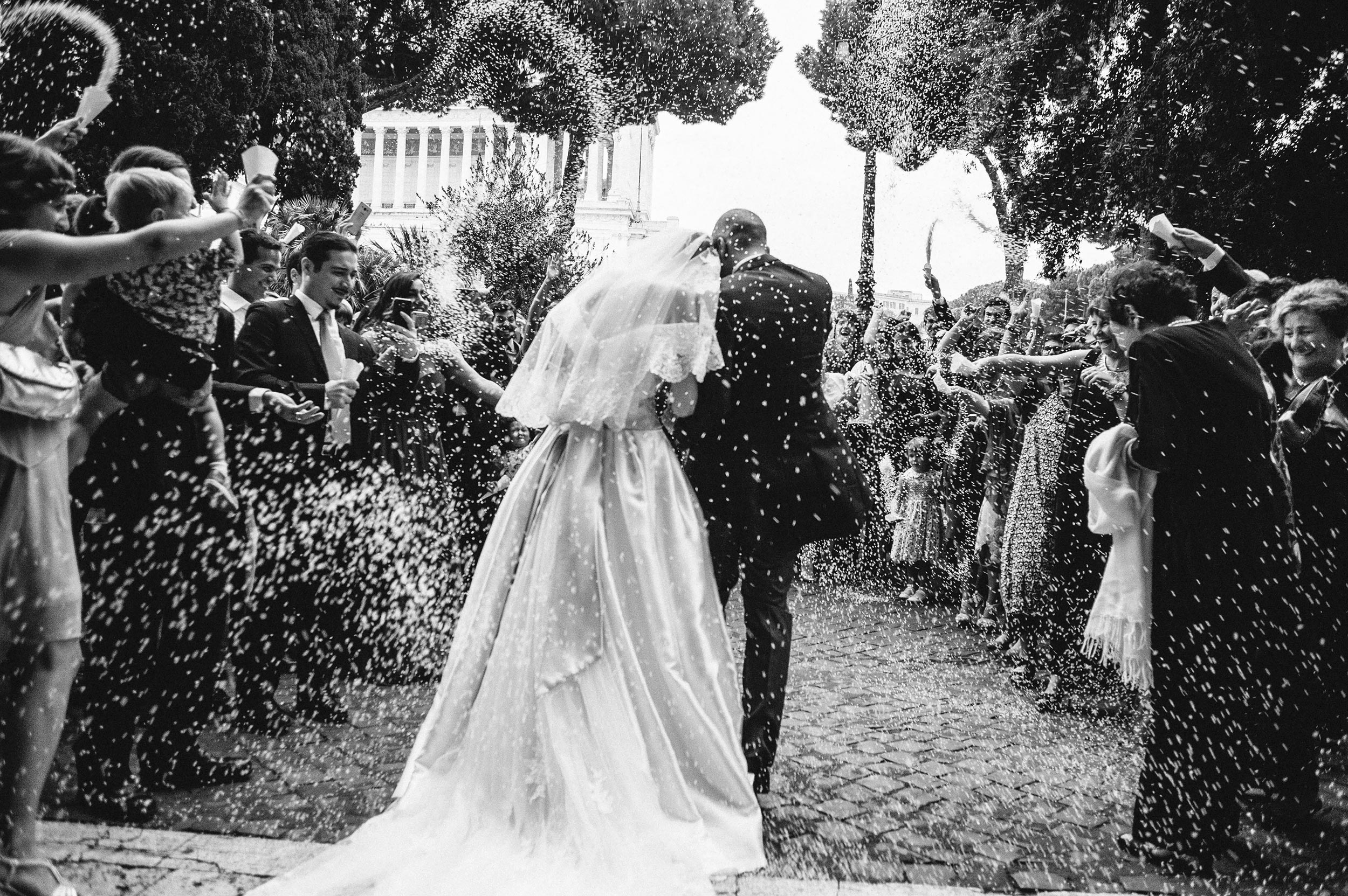 confetti-rice-outside-the-church-rome-san-marco-black-and-white-wedding-photography.jpg