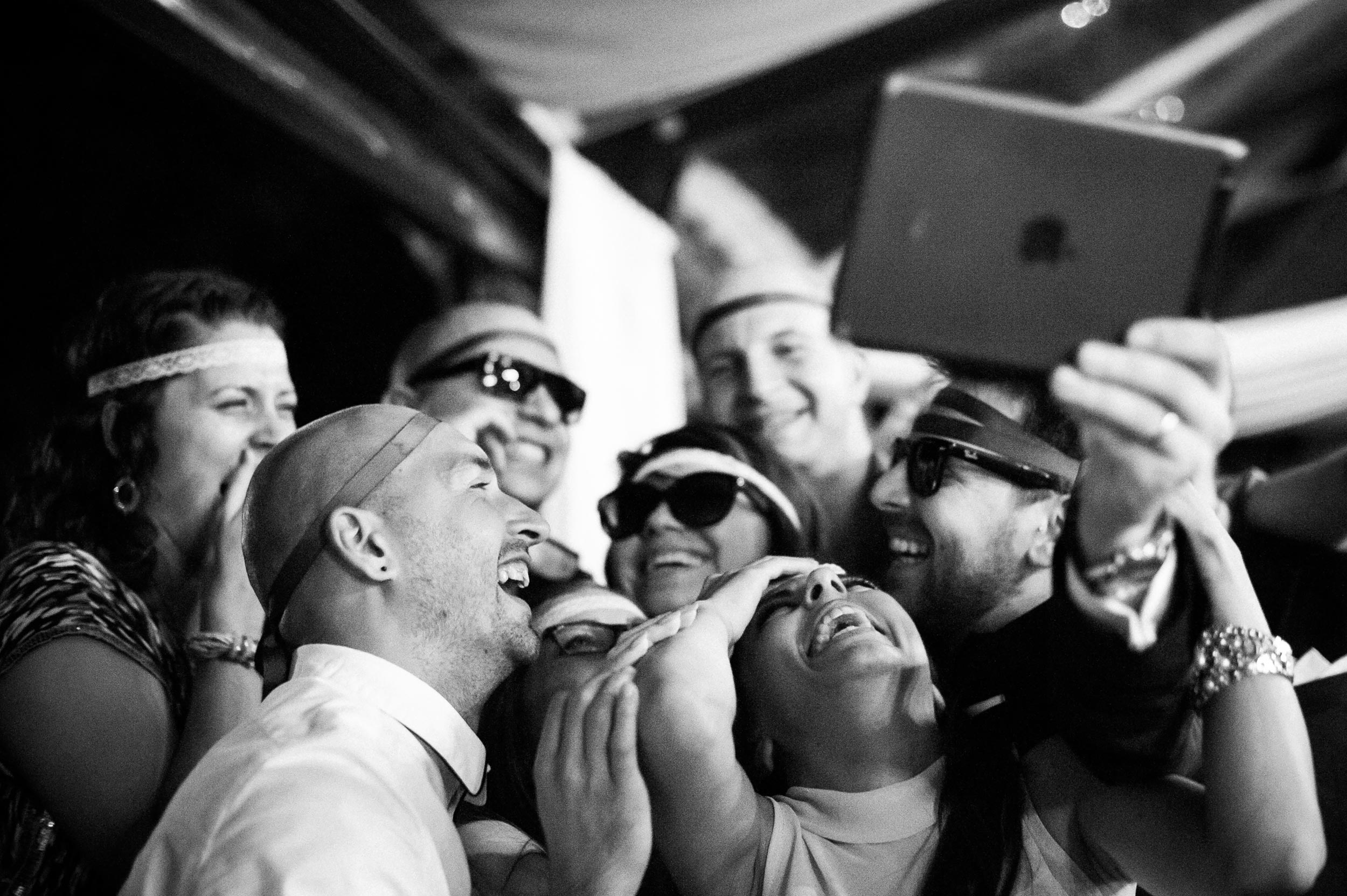 guests-having-fun-with-selfies-at-wedding-reception-in-rome-italy-black-and-white-wedding-photography.jpg