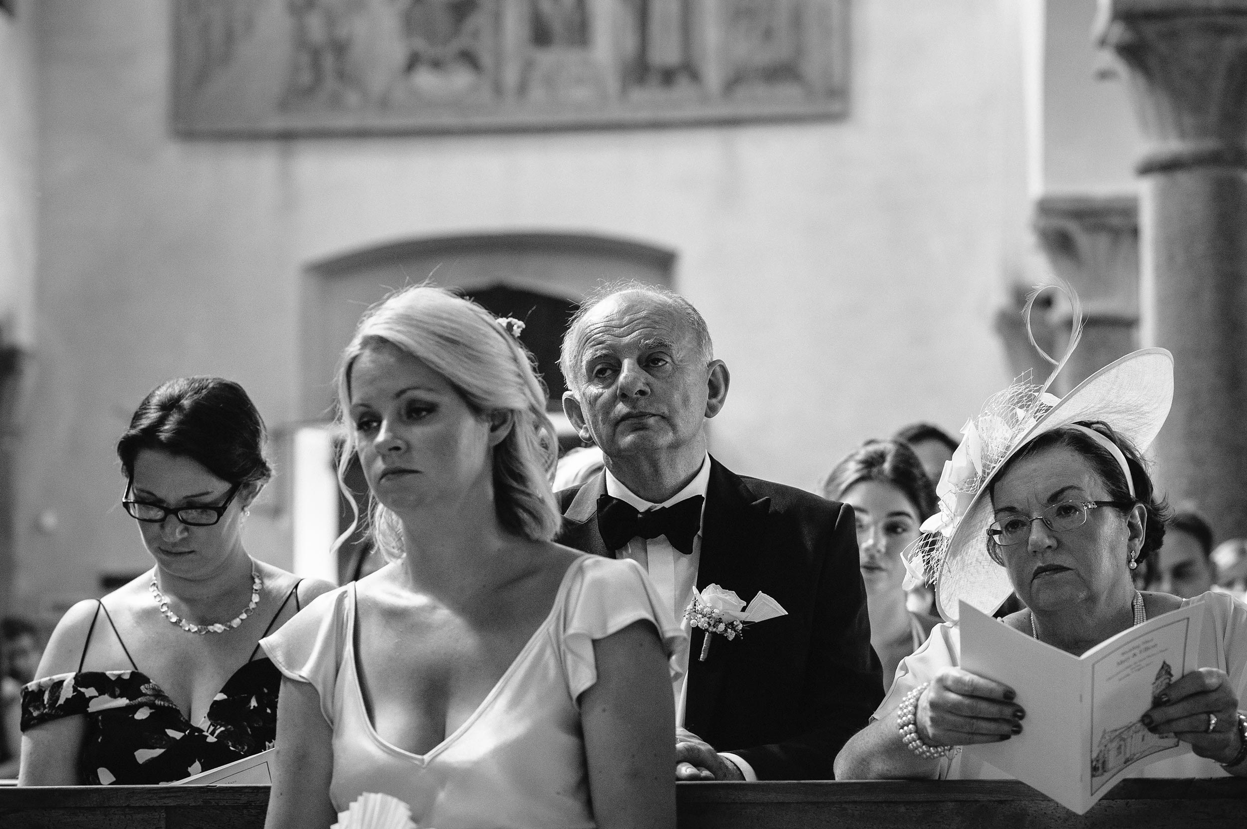 bored-guests-ceremony-black-and-white-wedding-photography.jpg