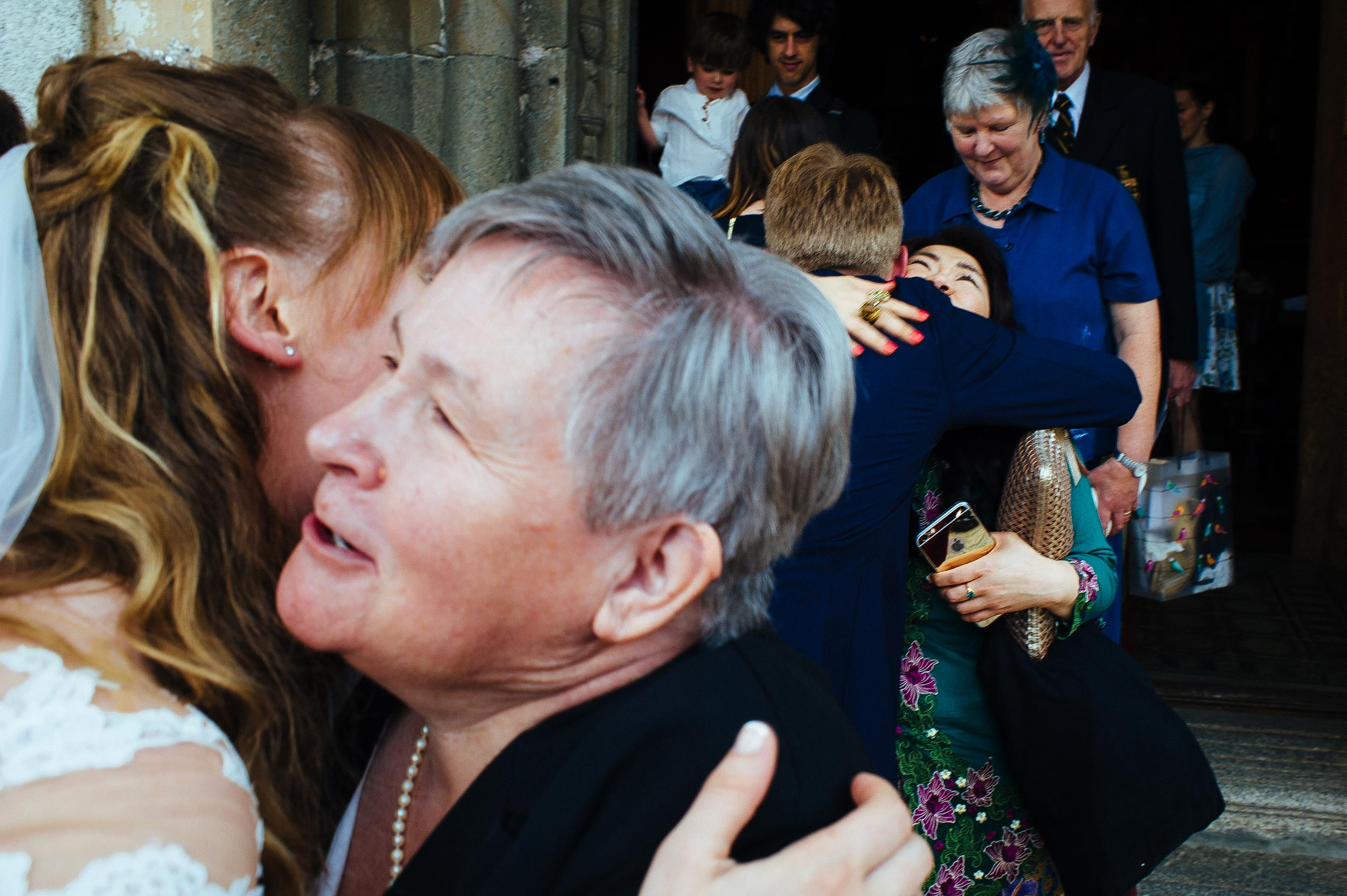 bride-and-groom-kissing-people-outside-the-church-wedding-lake-orta-italy.jpg
