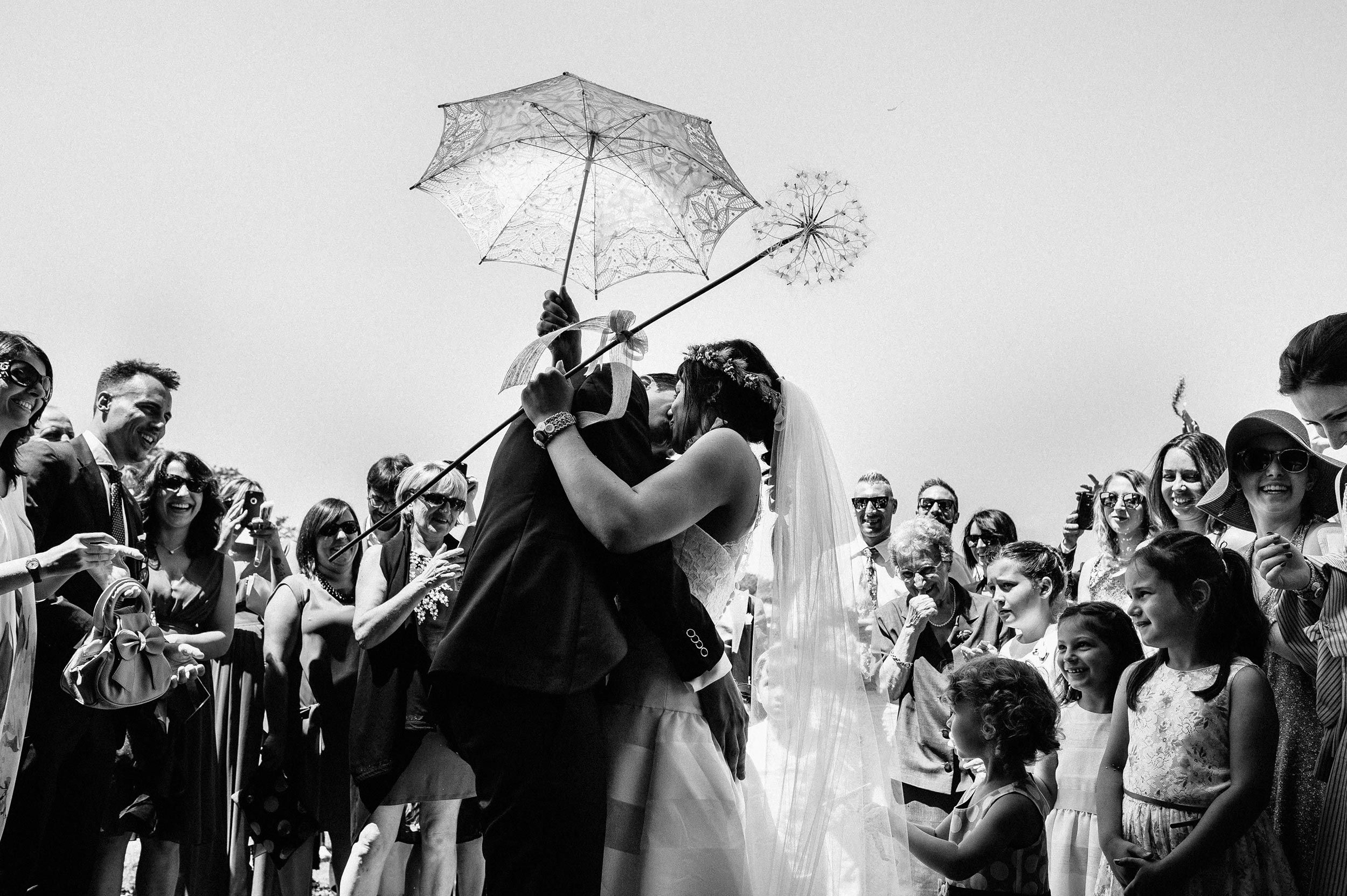 bride-and-groom-kissing-outside-the-church-black-and-white-wedding-photography.jpg