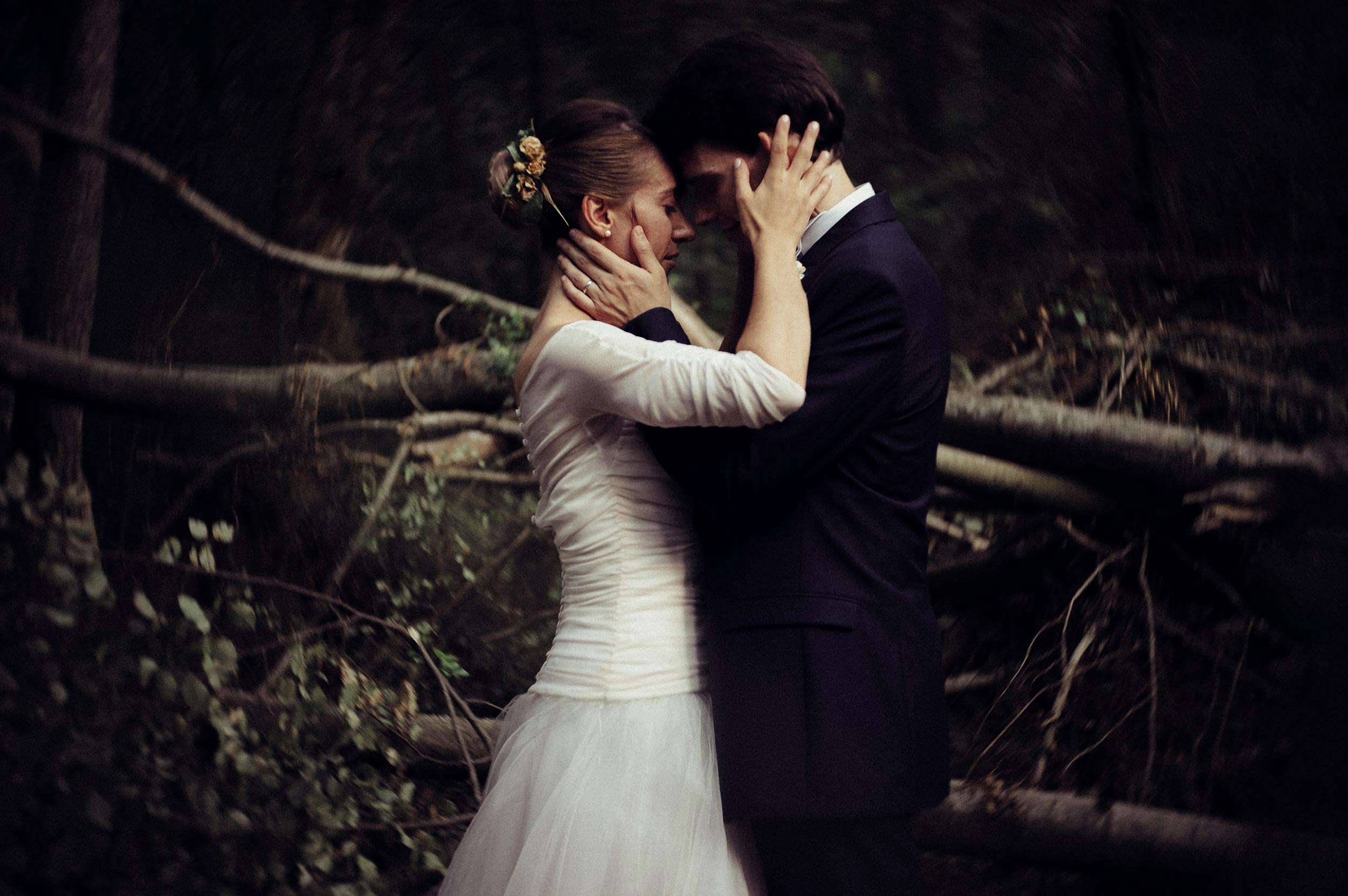 romantic-orange-teal-bride-and-groom-portrait-in-the-woods-looks-like-film.jpg