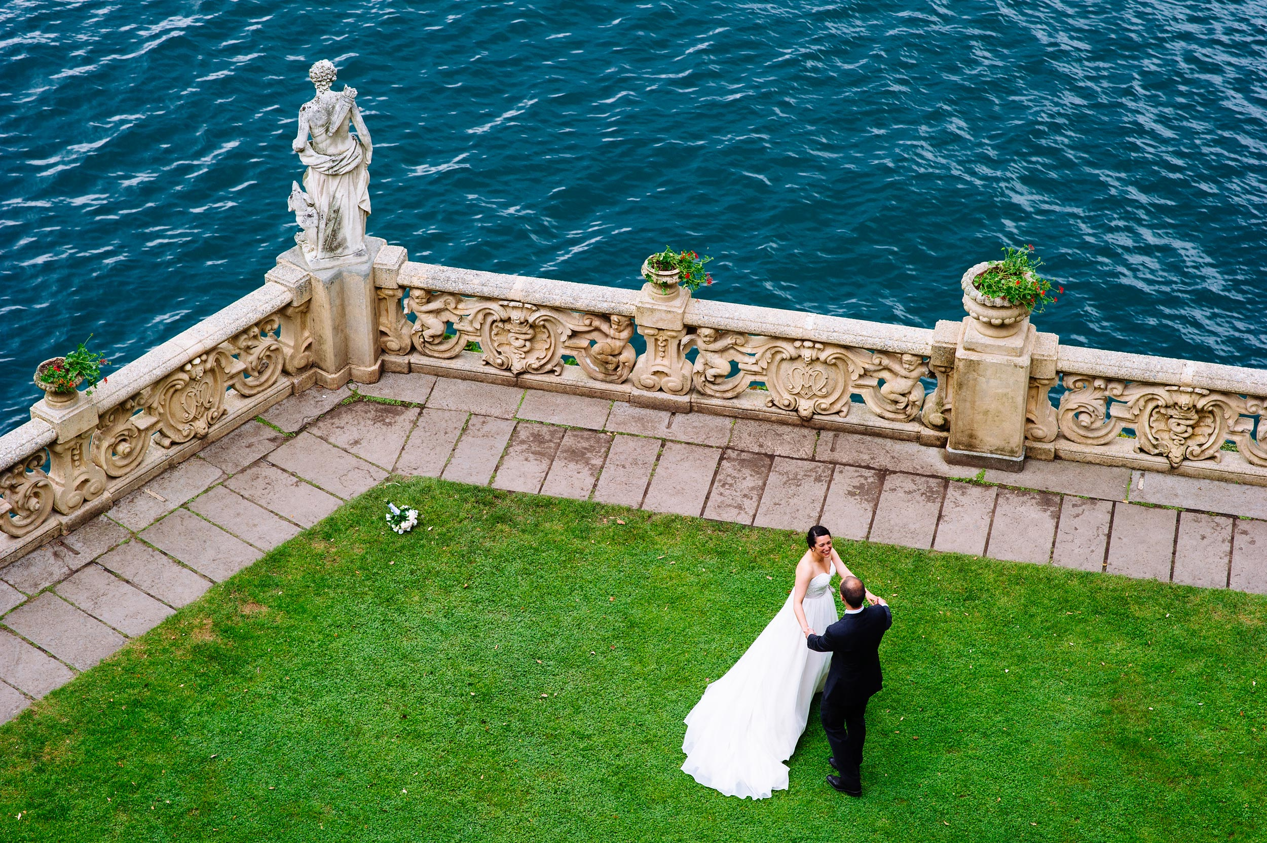 bride-and-groom-dancing-balcony-Villa-Del-Balbianello-Bellagio-Lake-Como-Wedding-Photographer-Italy-Alessandro-Avenali.jpg
