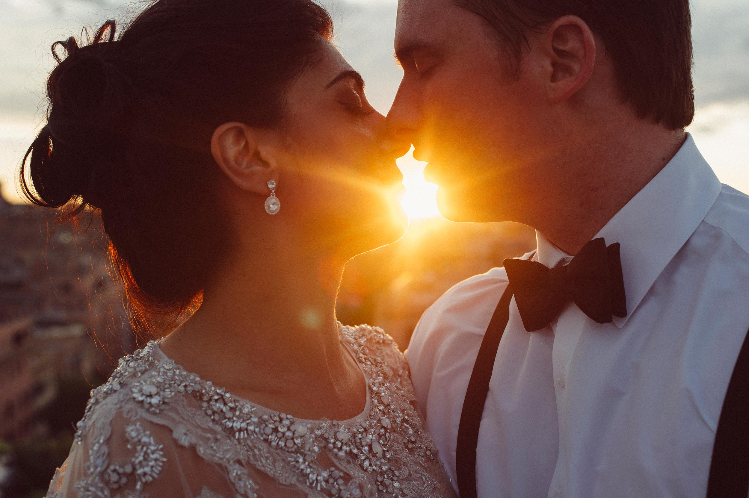 bride-and-groom-kissing-at-sunset-in-rome-vatican.jpg