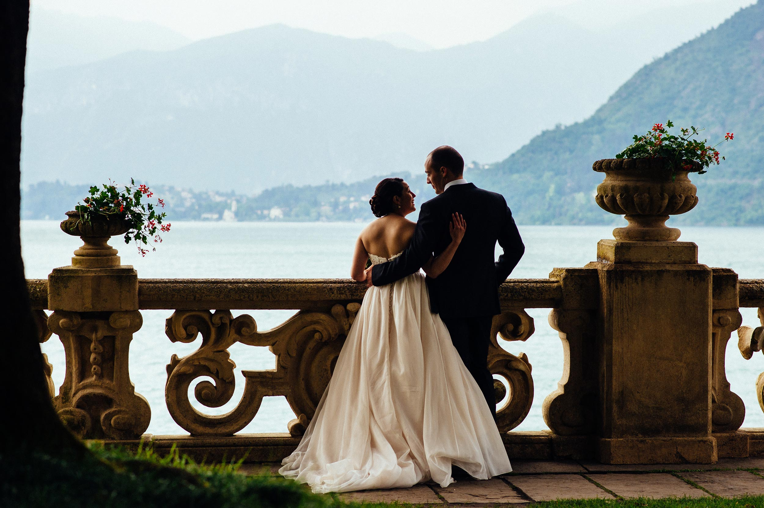 bride-and-groom-looking-balcony-Villa-Del-Balbianello-Bellagio-Lake-Como-Wedding-Photographer-Italy-Alessandro-Avenali.jpg
