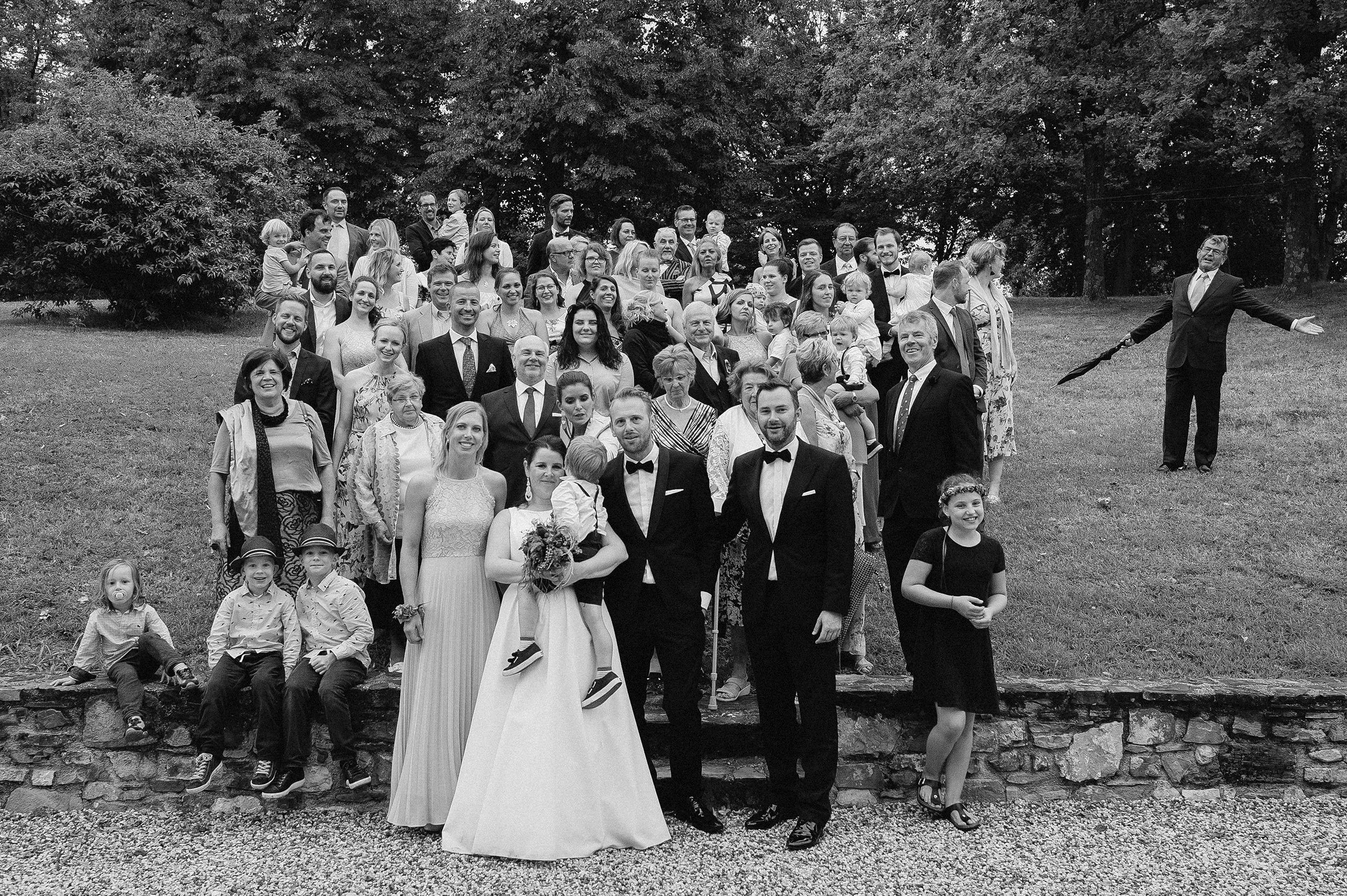 Wedding in Italy. Impatient guest protests during the group photo.