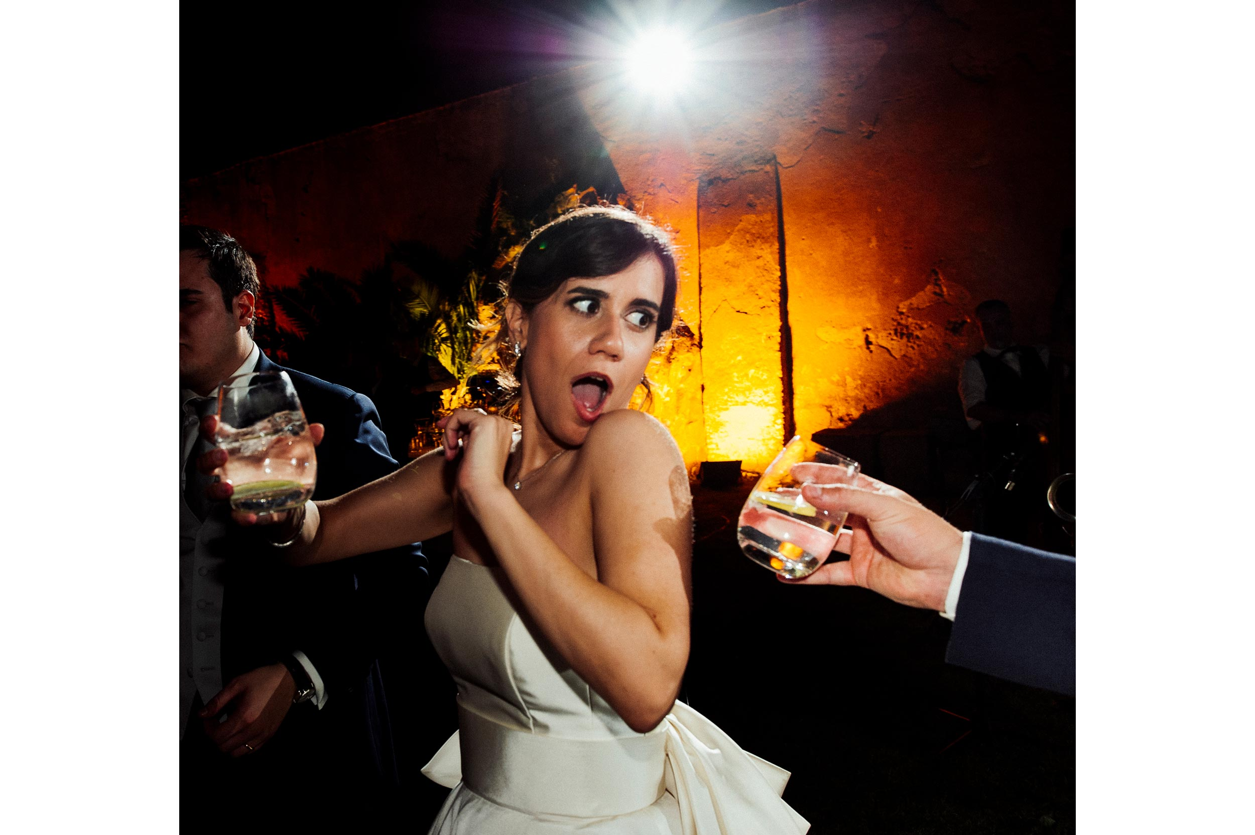 Bride refusig water during wedding party candid wedding photography by Alessandro Avenali
