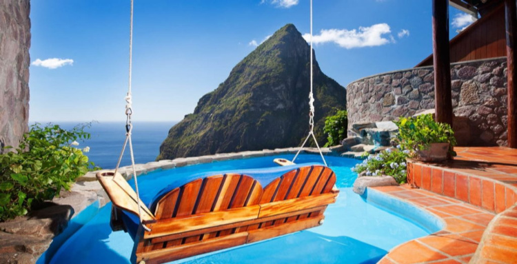 "Ladera Resort, St. Lucia- Your suite's ""open wall"" gives way to a private plunge pool and magnificent views of the Pitons and Caribbean."
