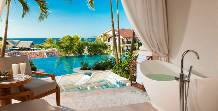 Sandals Grenada—Upgrade to a special room with more ambiance. This room spells romance all over. Infinity Edge plunge pool that blends with the horizon in this Sky Pool Suite with tub on deck.. Picture by Bill Ross Photography.