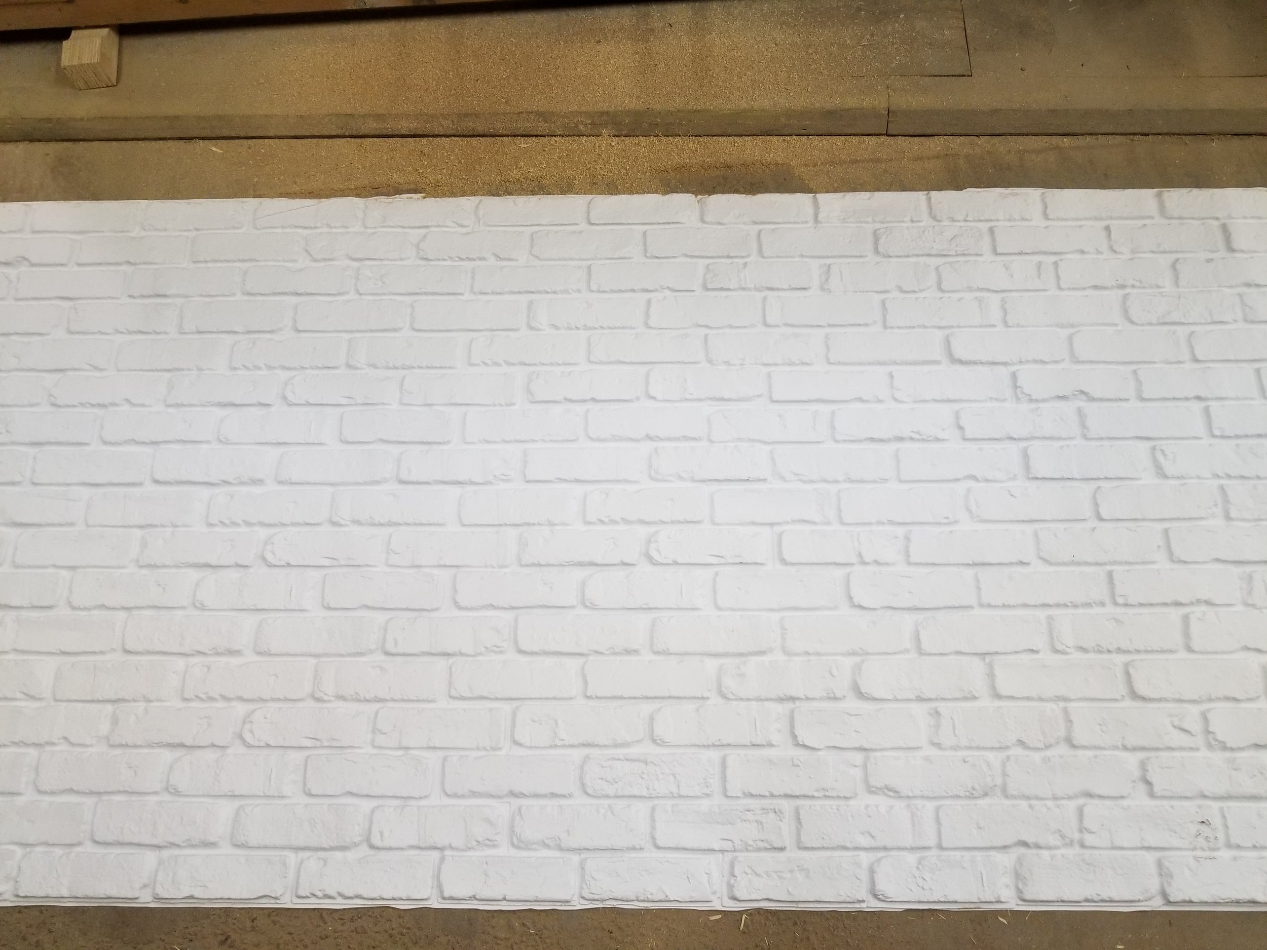 Plastic brick pulled from the mold