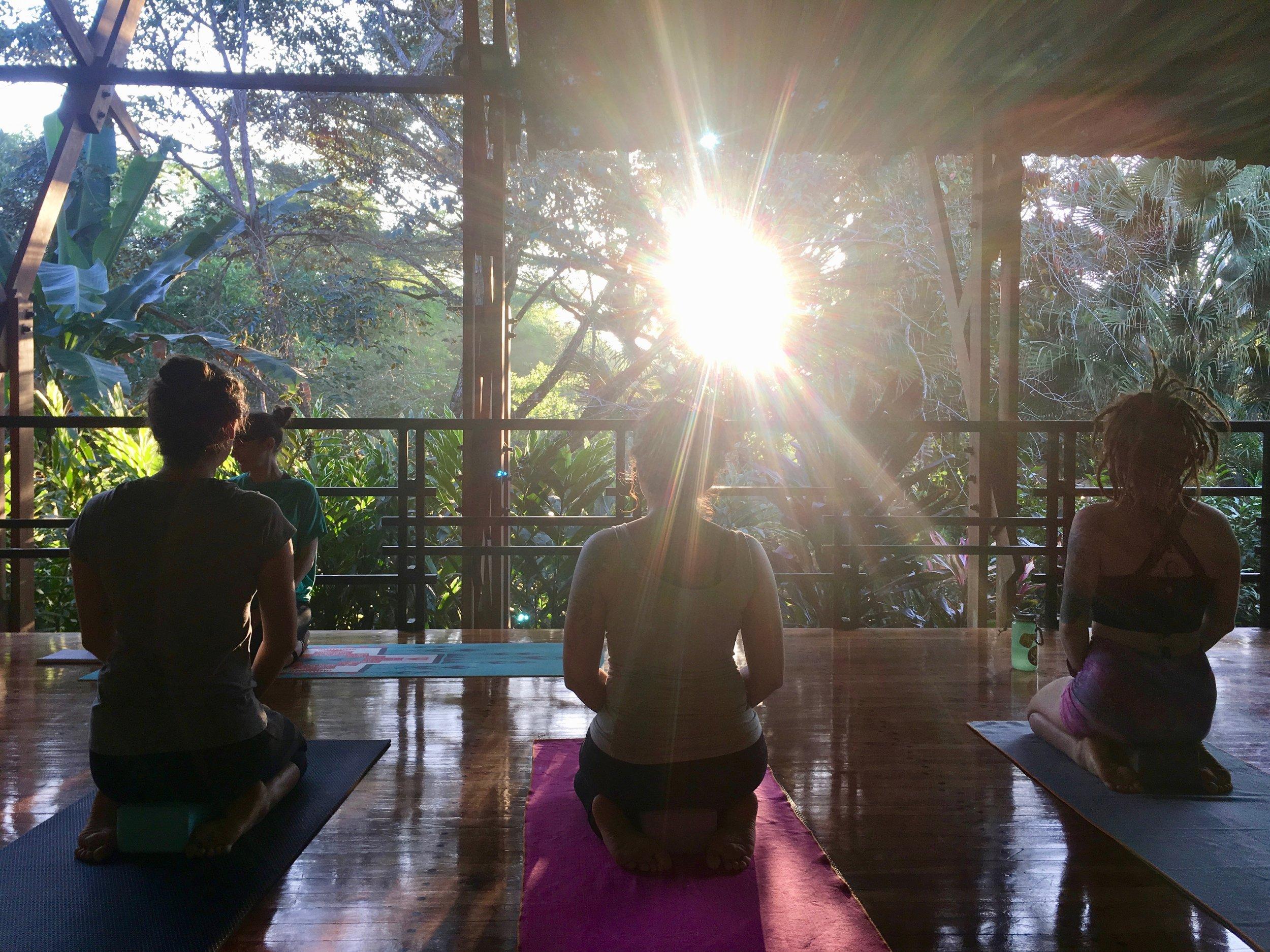 3 girls meditating with sun.jpg