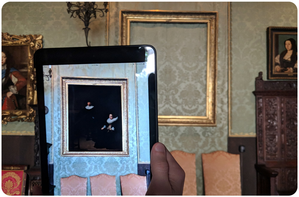 "Rembrandt's ""A Lady and Gentleman in Black"" displaying using Augmented Reality."