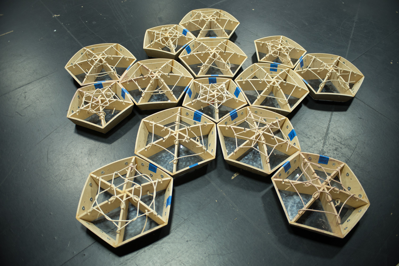 TZ'IJK.1.  Hexagonal and pentagonal wooden frames ready to be assembled.