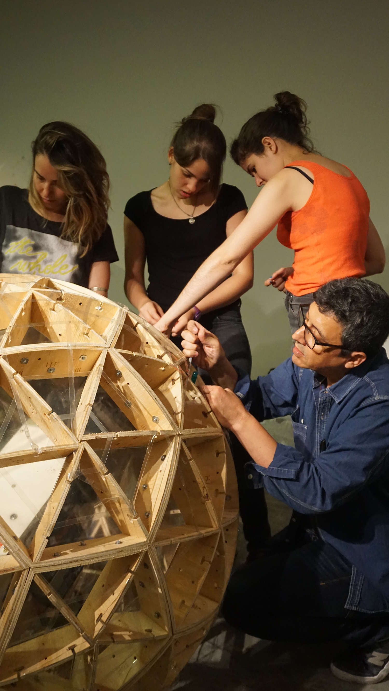 TZ'IJK.3.  Assembly of wooden geodesic sphere.