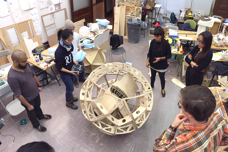 TZ'IJK.2.  RPI engineering students testing the pendulum mechanical system.