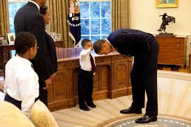 Young Boy Touching Obama's Hair