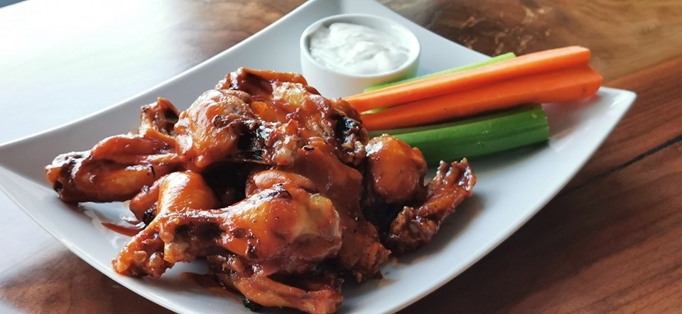 WINGS WITH YER BUD - Every Thursday, get a pound of chicken wings tossed in one of our delicious sauces or a simple but tasty dry rub with a Bud Light for $14 OR a pound of wings sans beer for $9.