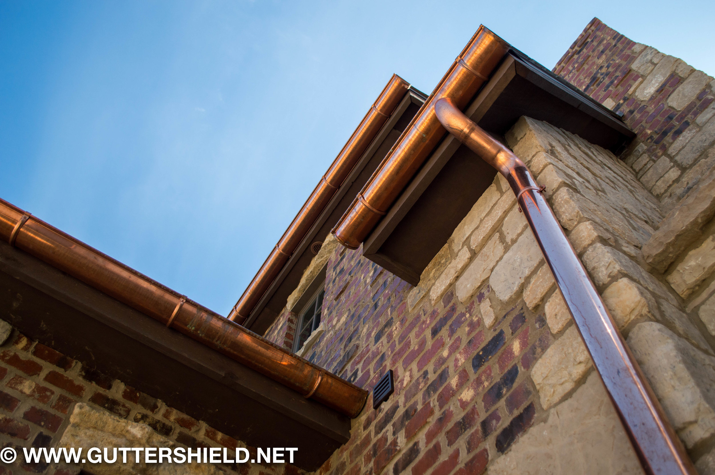 copper-half-round-gutters-lake-house-lifestyle.jpg